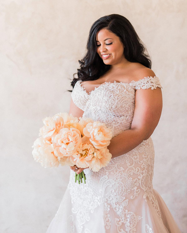 bride wearing lace off-the-shoulder wedding dress