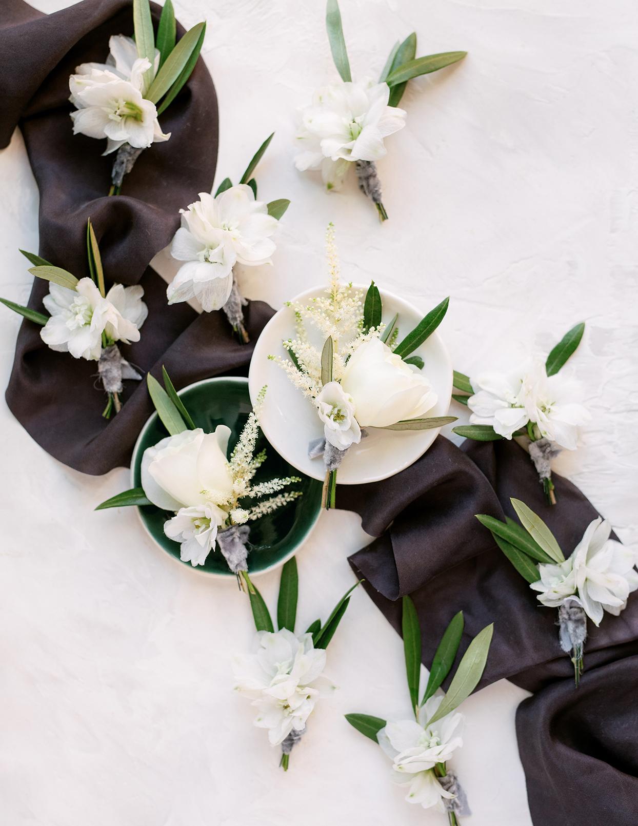 jason justin white floral wedding boutonnieres