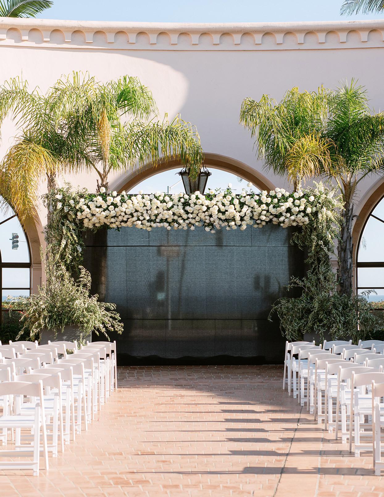 jason justin wedding ceremony white floral arch