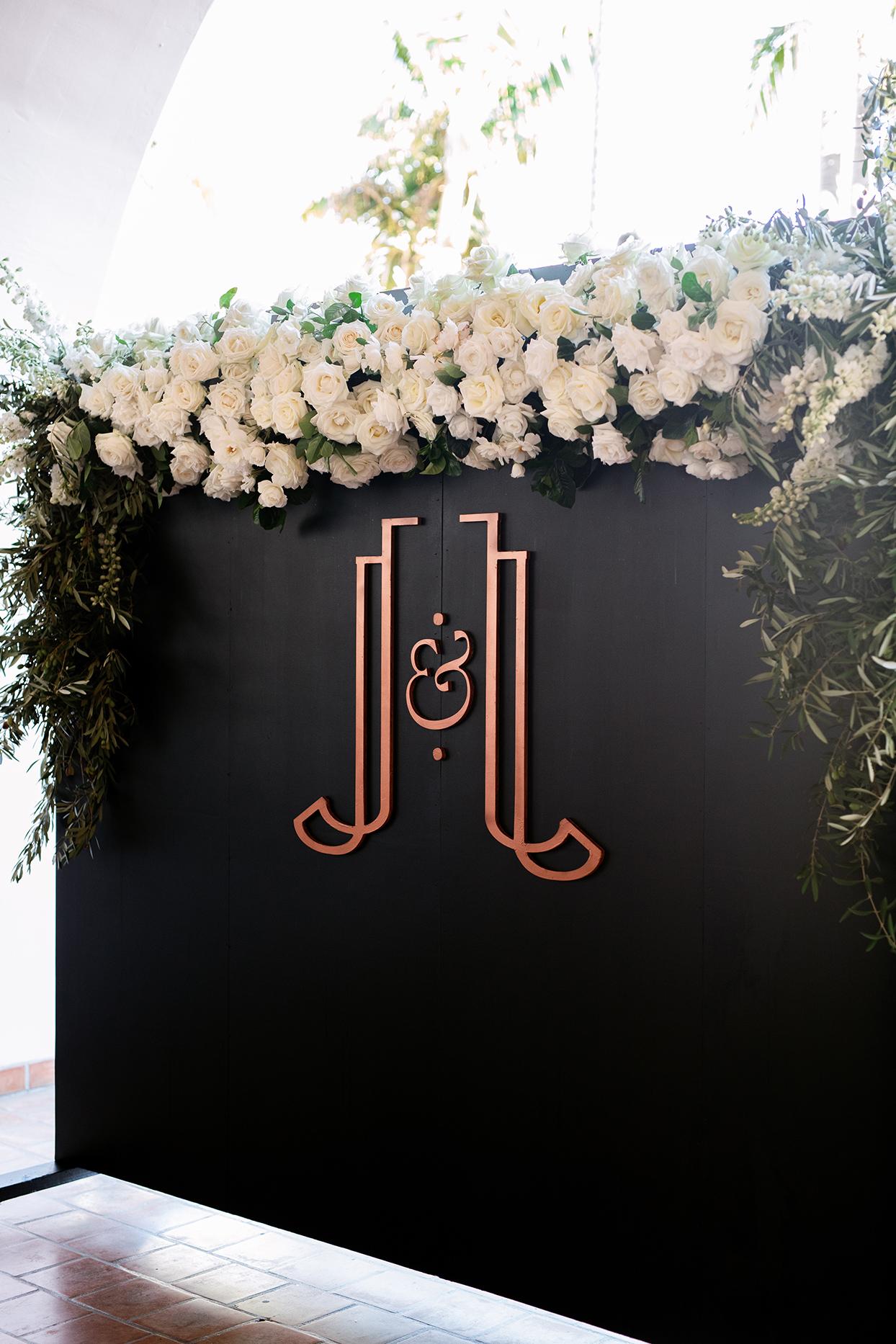 jason justin wedding ceremony monogrammed logo wall