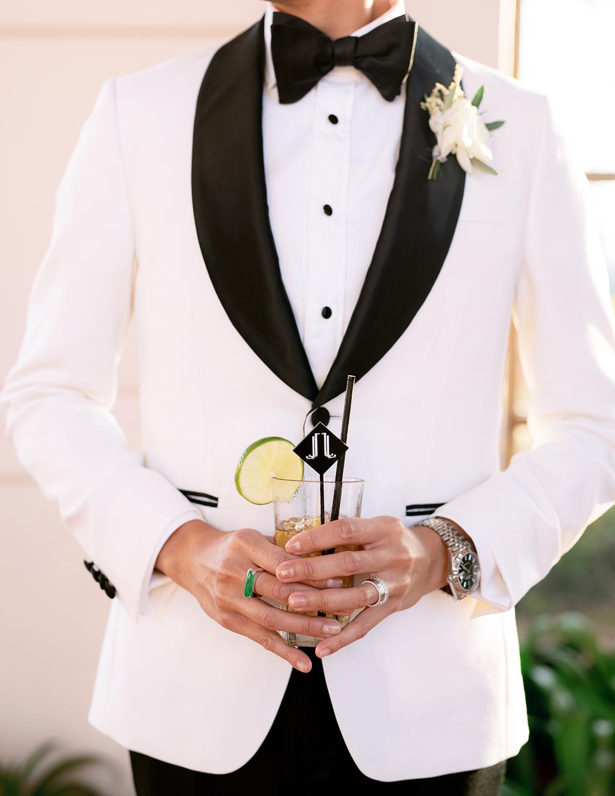jason justin holding wedding drinks