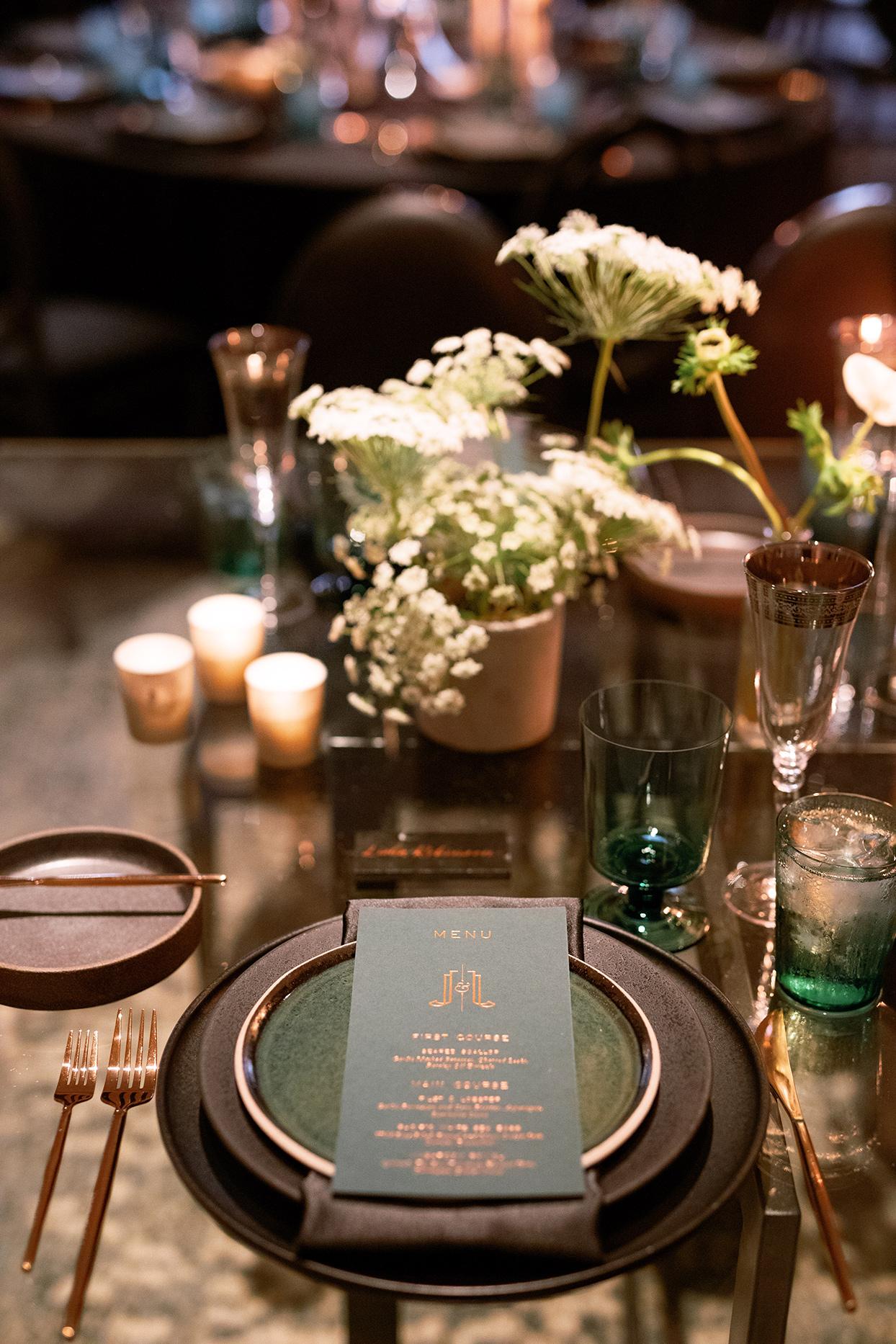 jason justin wedding reception dark tones place setting