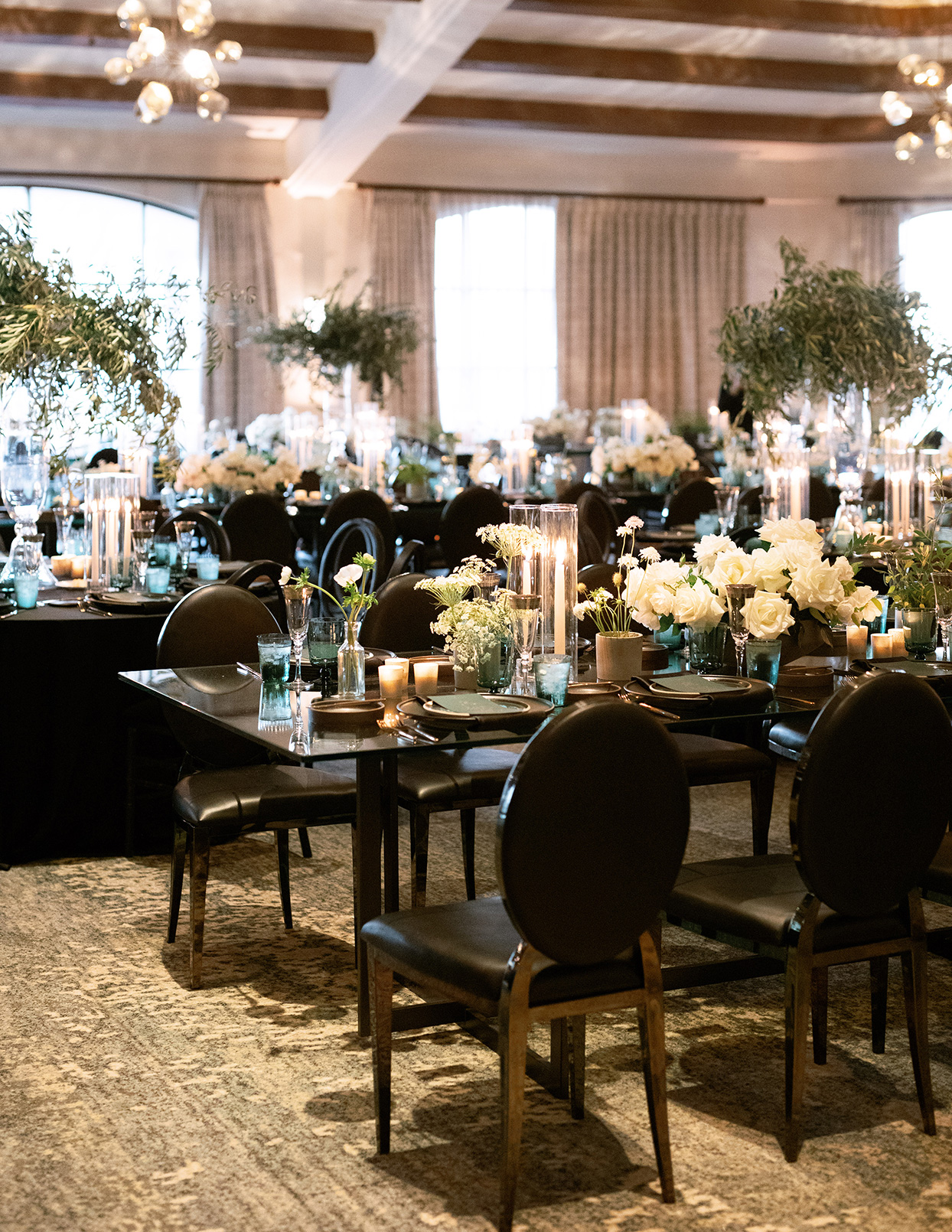 jason justin wedding reception black chairs and tables