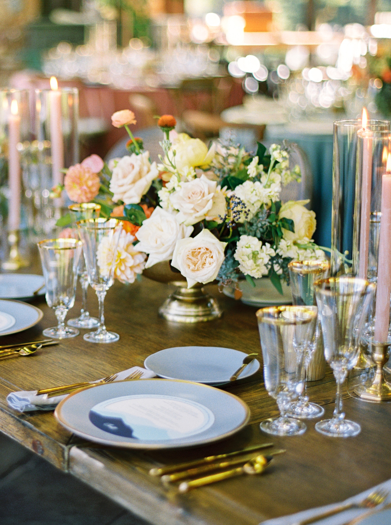 Wooden tables with metallic urns filled with flowers