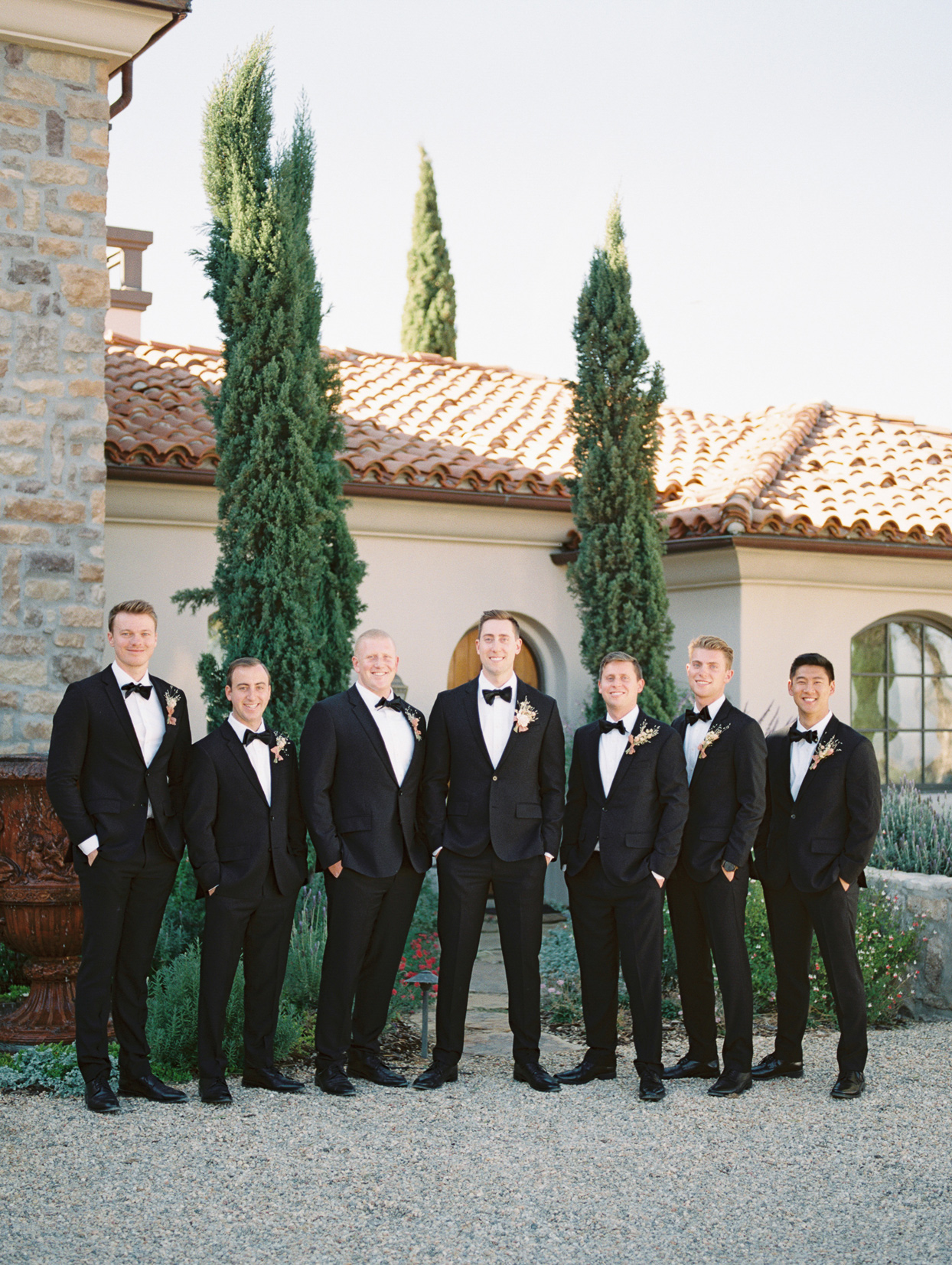 Groom and groomsmen in black tuxes from The Black Tux