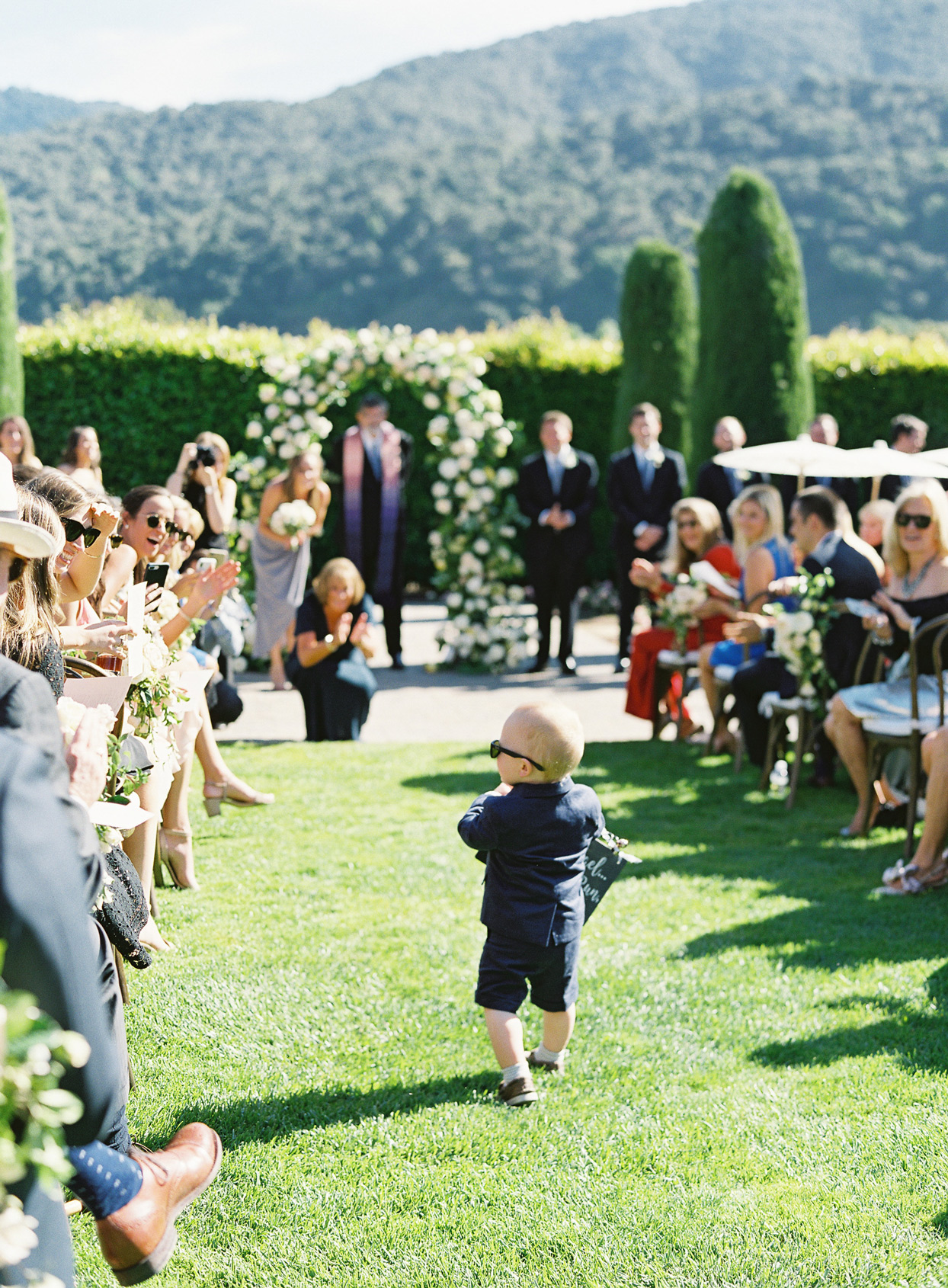 ring bearer walking doing processional aisle