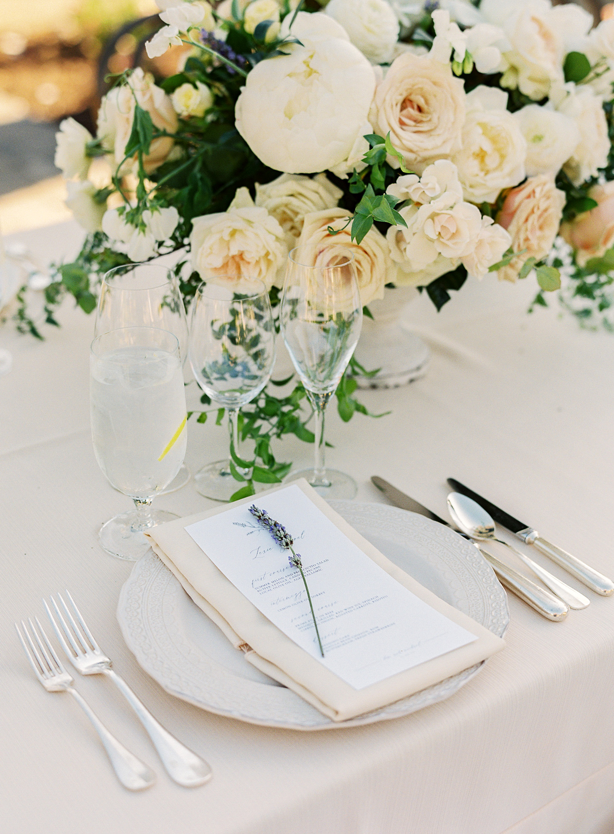 white and cream color themed table settings