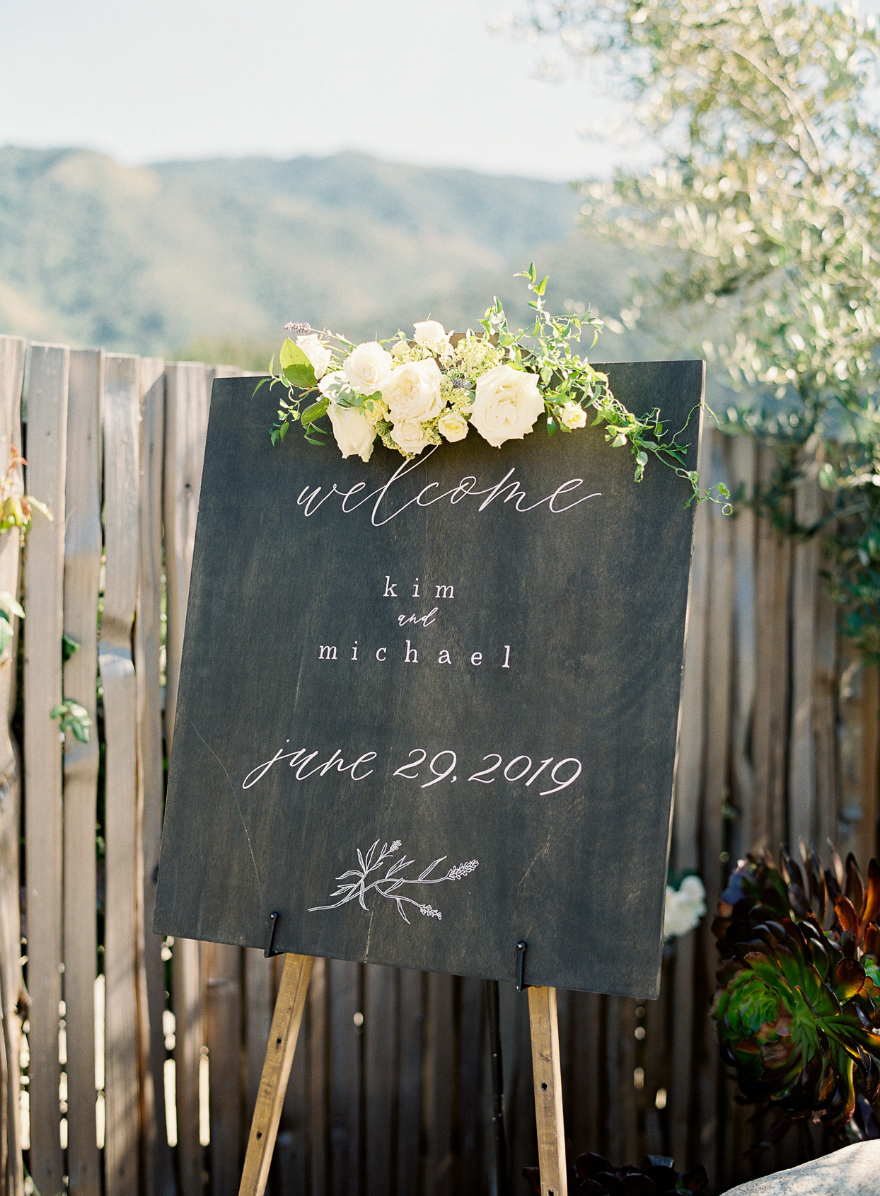 wooden canvas welcome sign