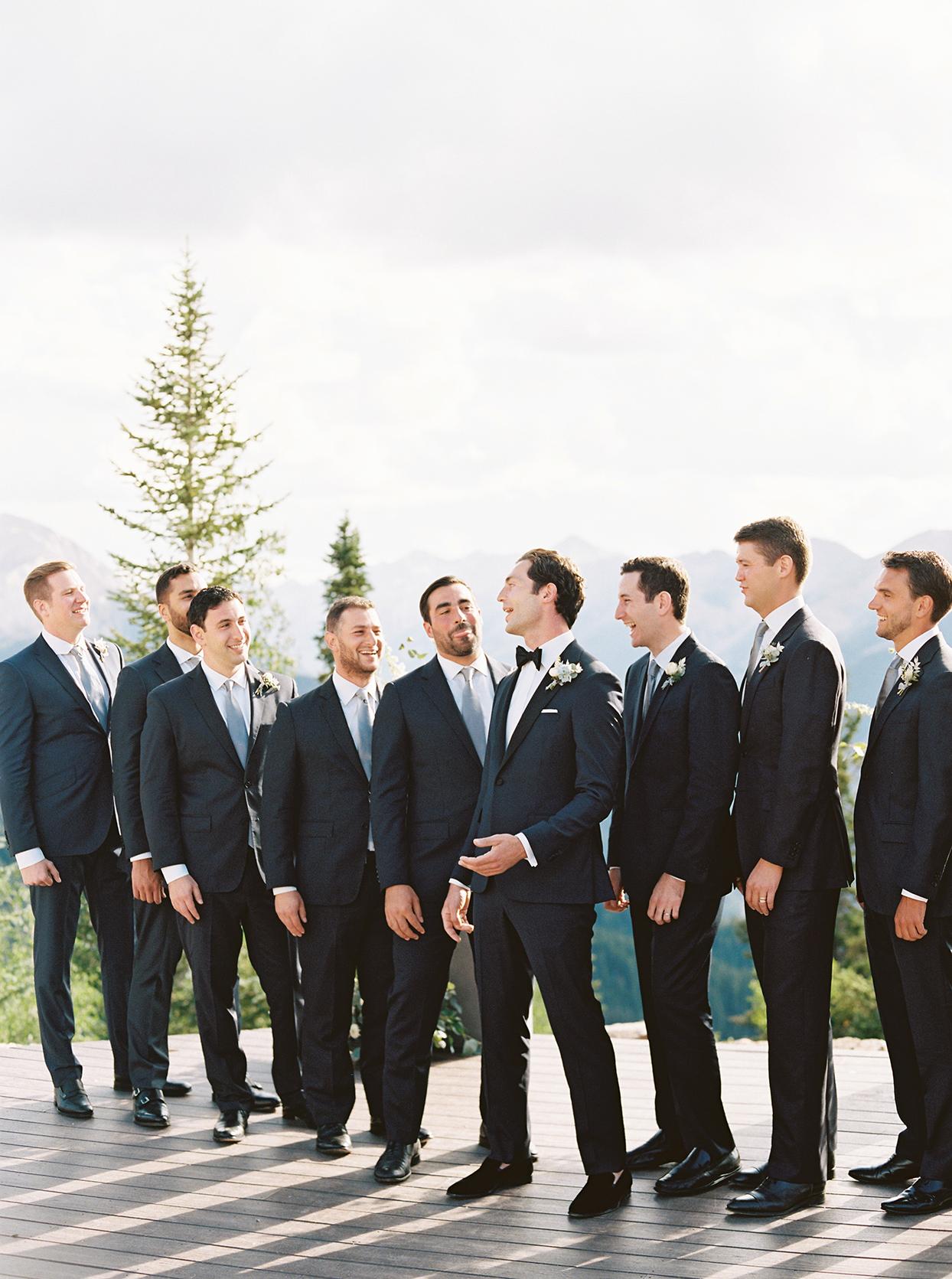 kimmie mike wedding groomsmen with mountain view
