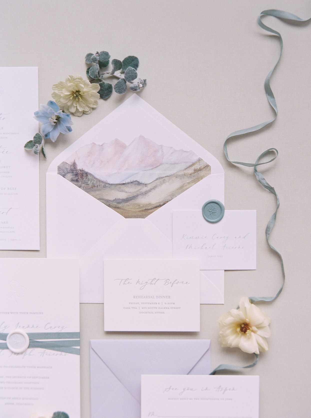kimmie mike wedding invitations with watercolor mountain drawing