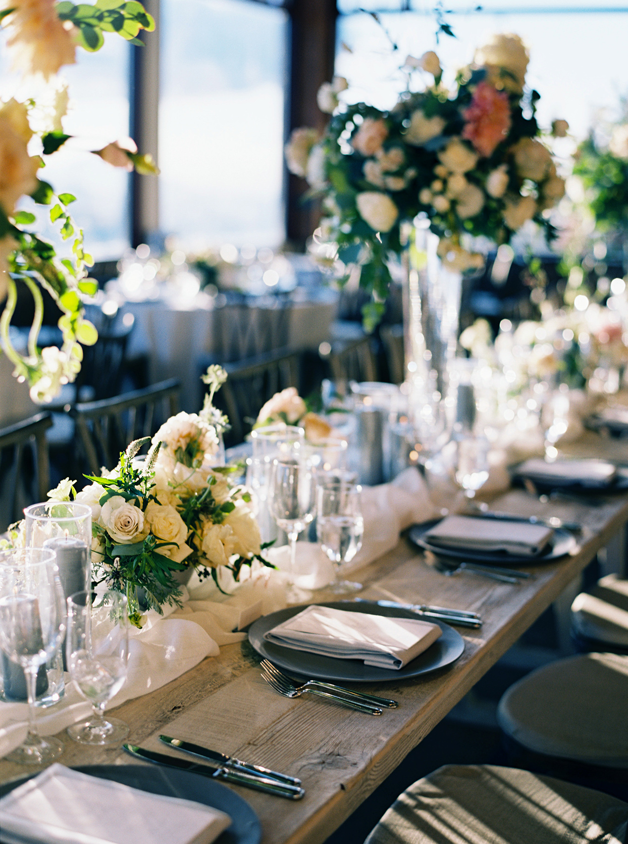 kimmie mike wedding reception wooden head table with flowers
