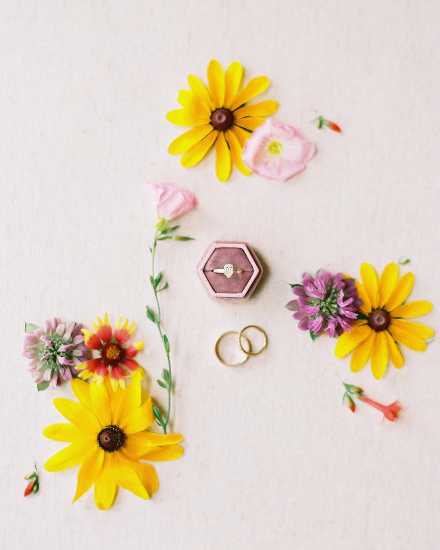 Wedding rings among wildflowers