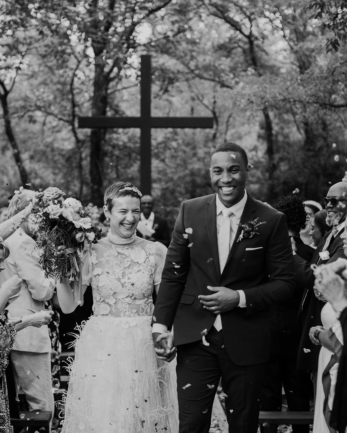 Couple walking down aisle after getting married