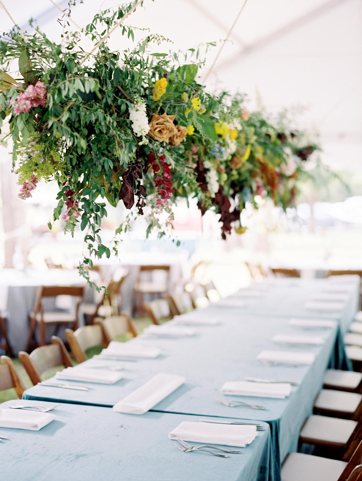 Long floral decor above tables