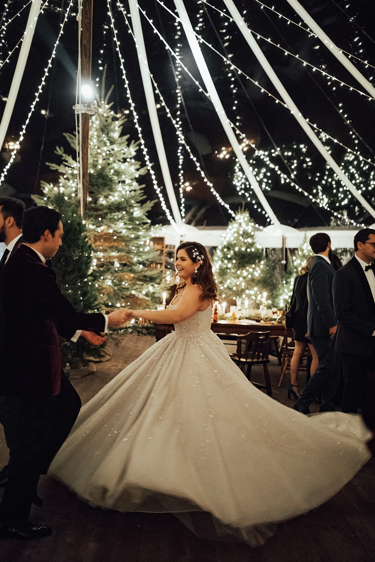 noelle danny wedding first dance bride twirling under lit tent