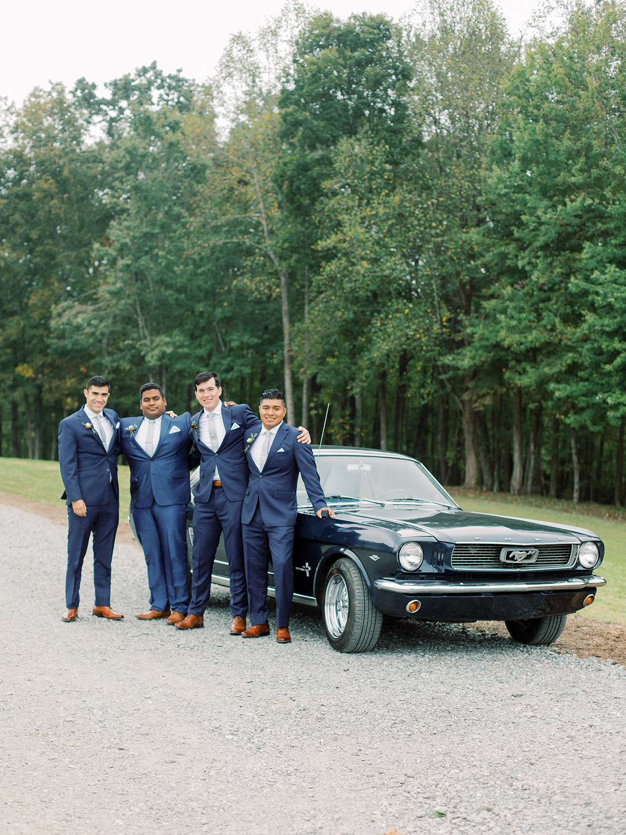 rebecca isaac wedding groomsmen with mustang
