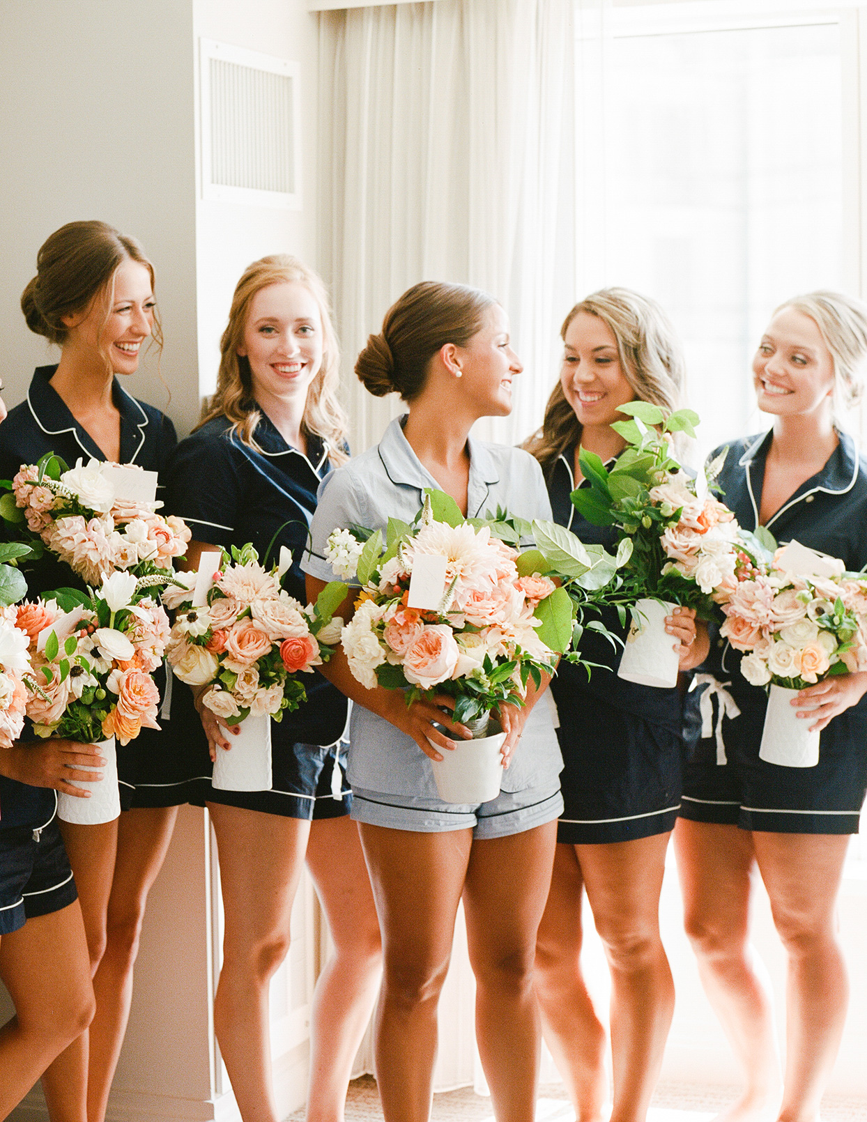 shelby david wedding bridesmaids in matching pjs holding flowers