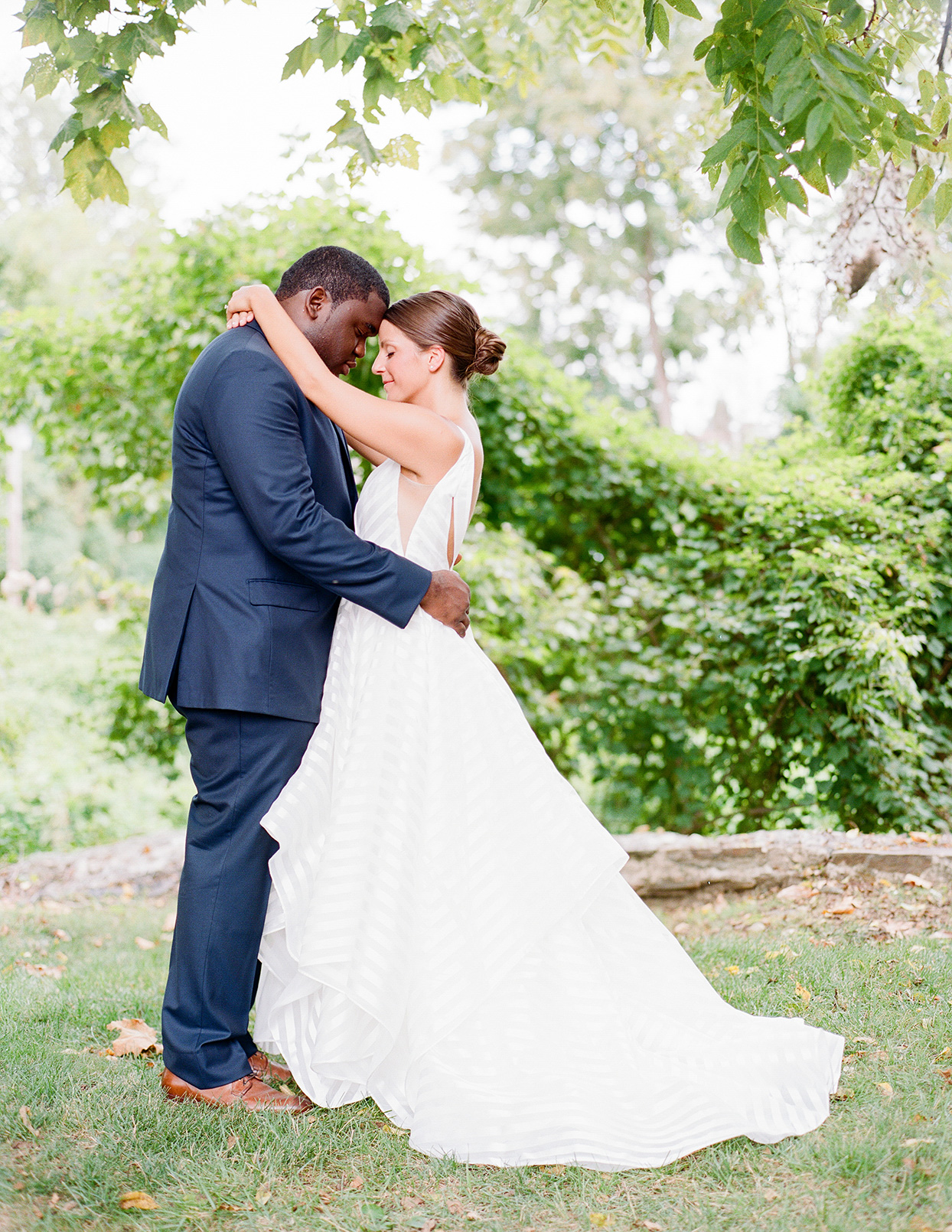 shelby david wedding couple hugging in front of trees