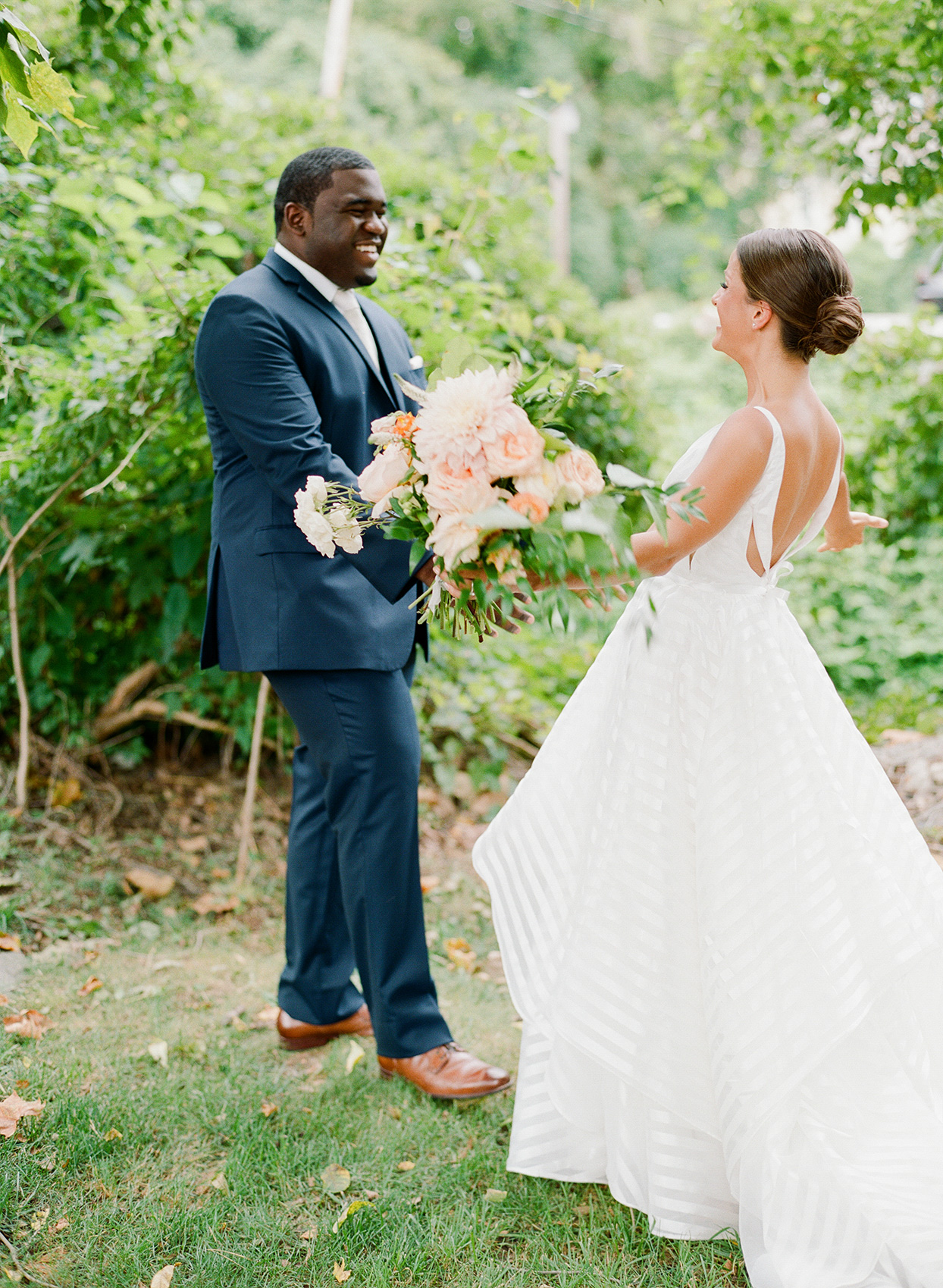 shelby david wedding first look outdoors with flowers