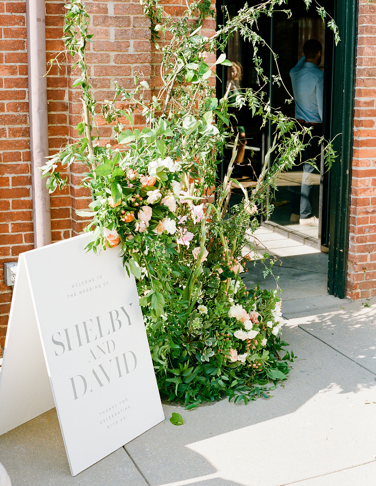 shelby david wedding sign and floral display