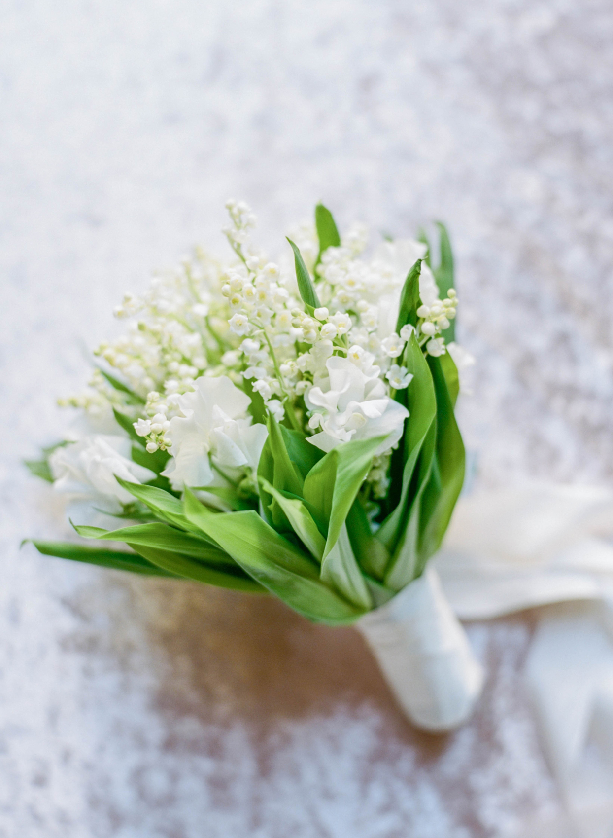 bridal bouquet of lily of the valley and sweet pea