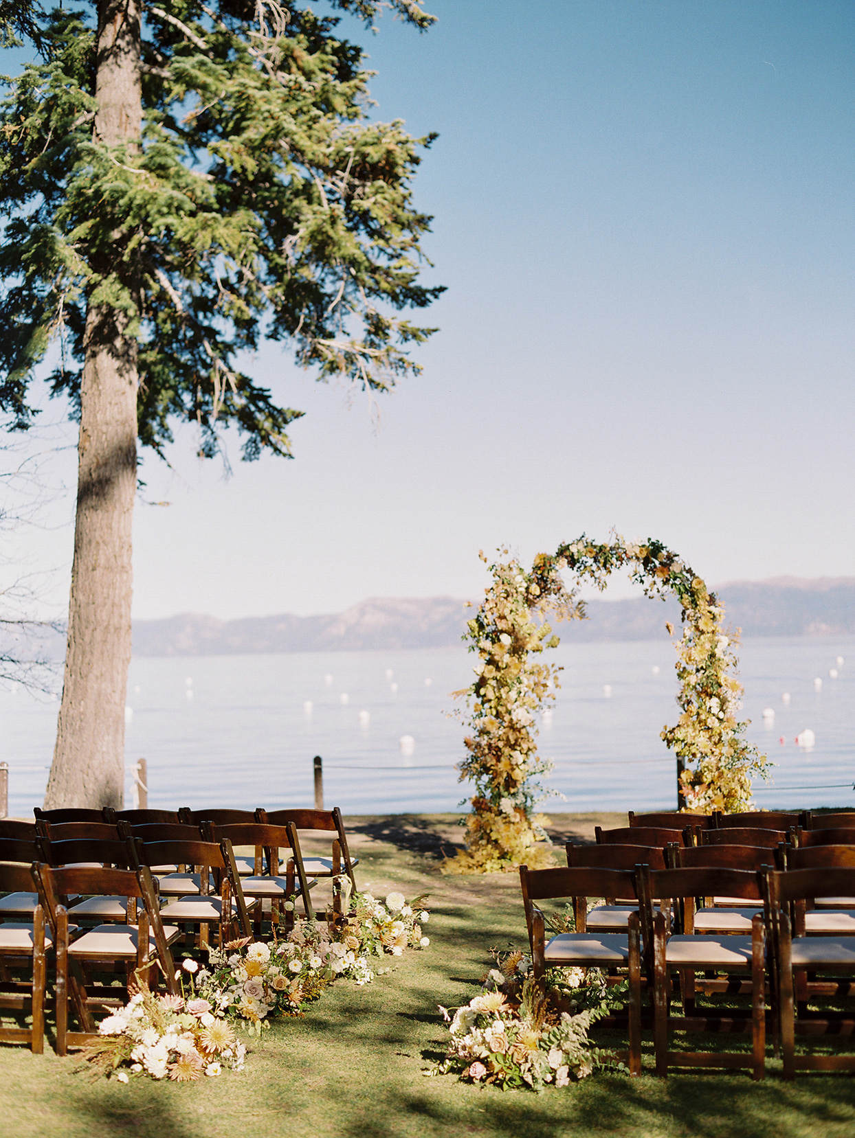 alexandra david wedding ceremony location floral arch overlooking lake