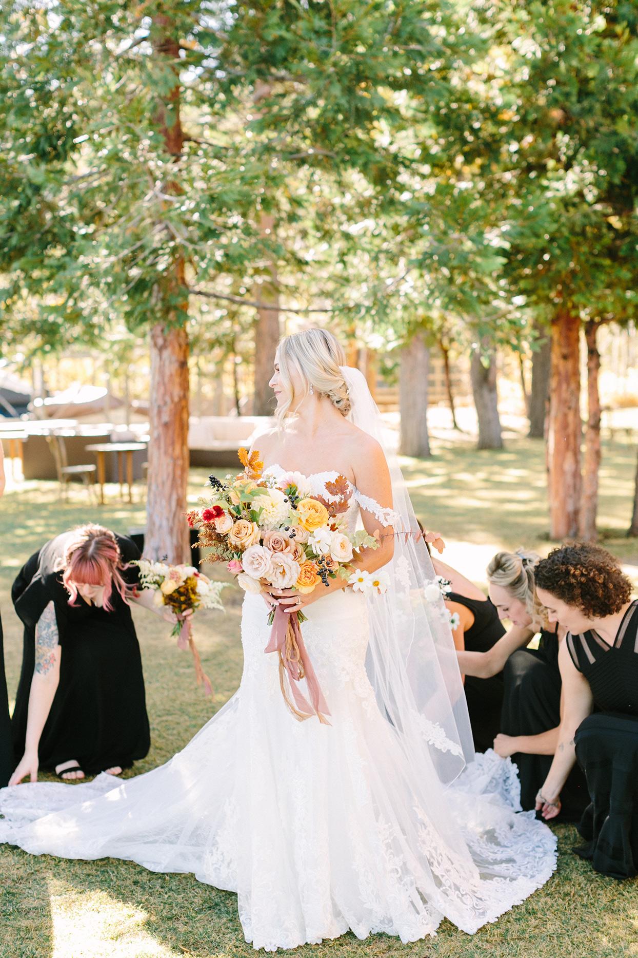 alexandra david wedding bride with maids adjusting dress