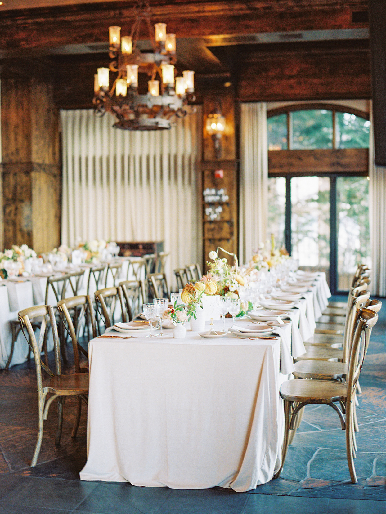 alexandra david wedding reception long table in rustic space