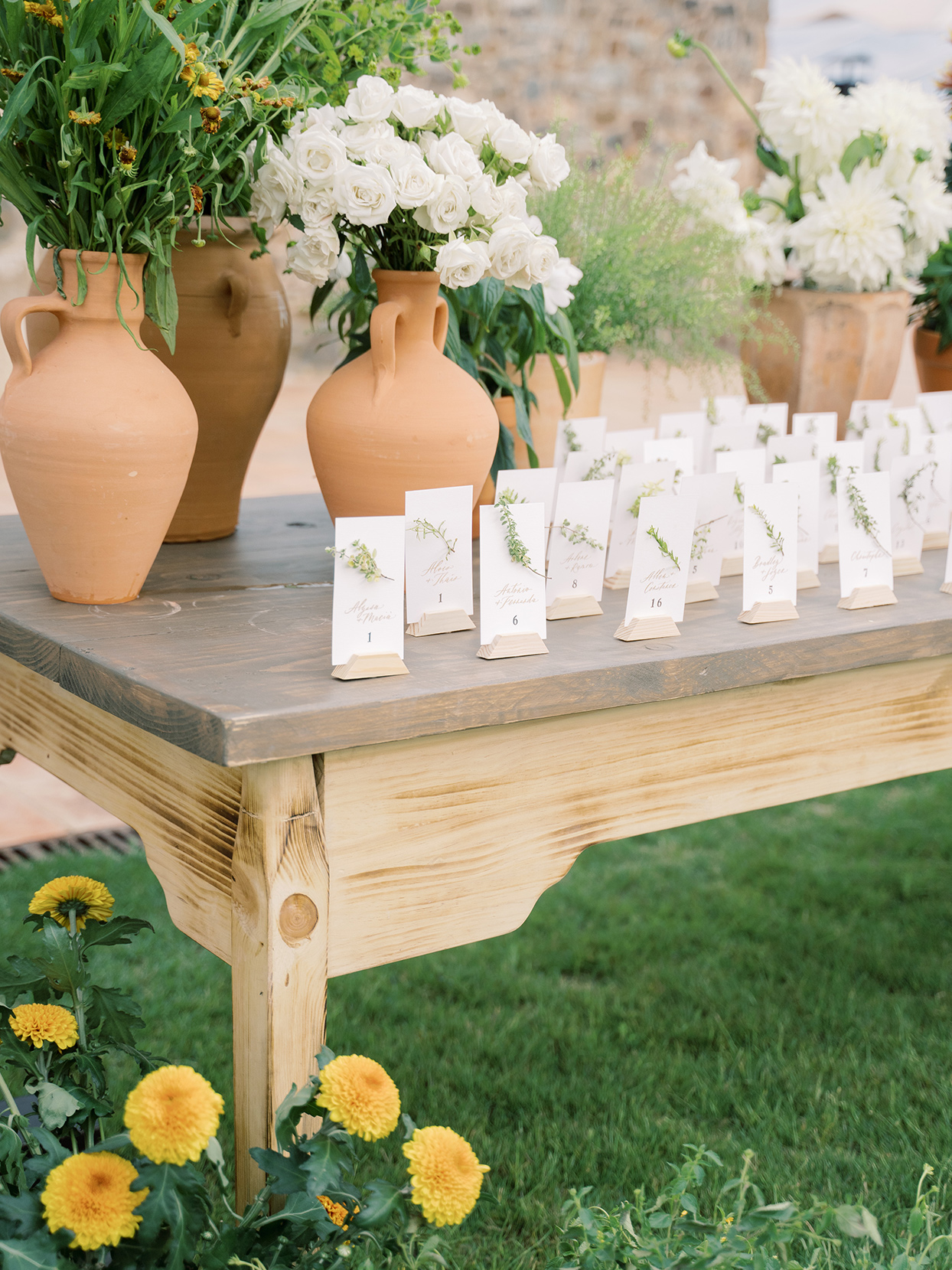 alyssa macia wedding escort cards on wooden table