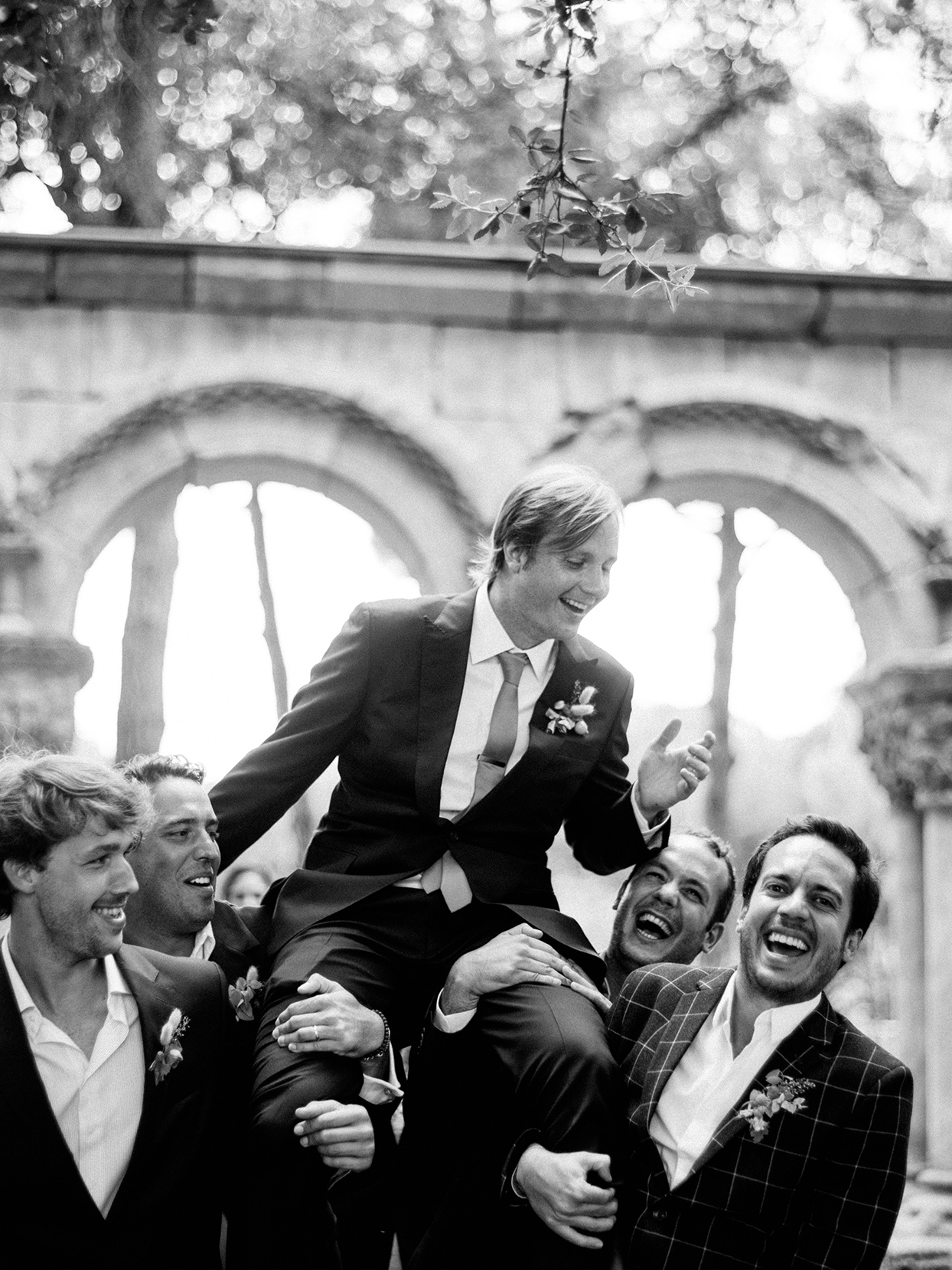 alyssa macia wedding groomsmen carrying groom and laughing