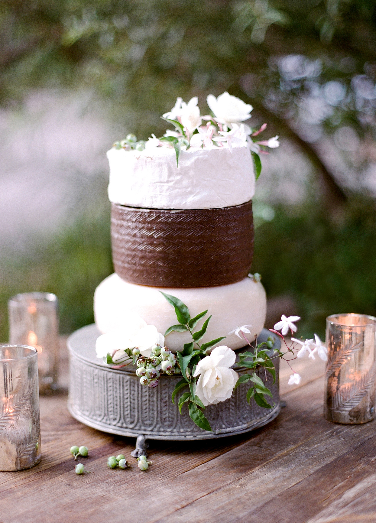 three tiered cheese rounds stacked mimicking wedding cake