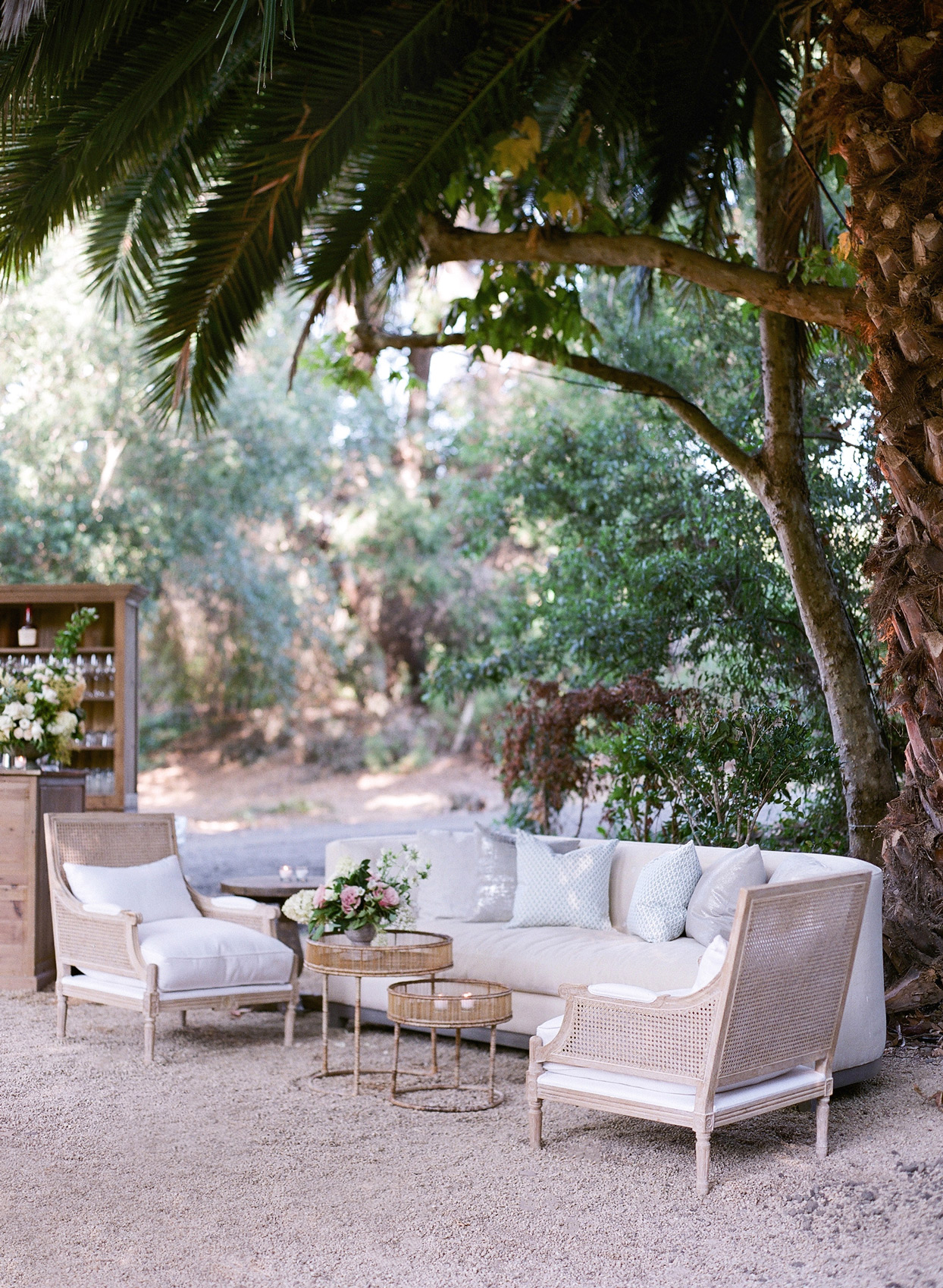 cream and white outdoor wedding lounge area