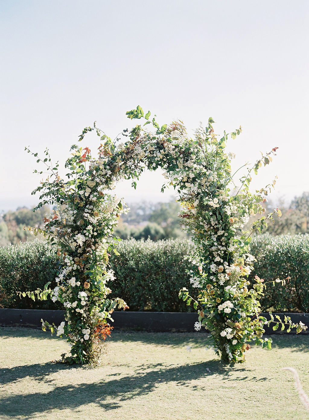 becca joey wedding ceremony floral arch
