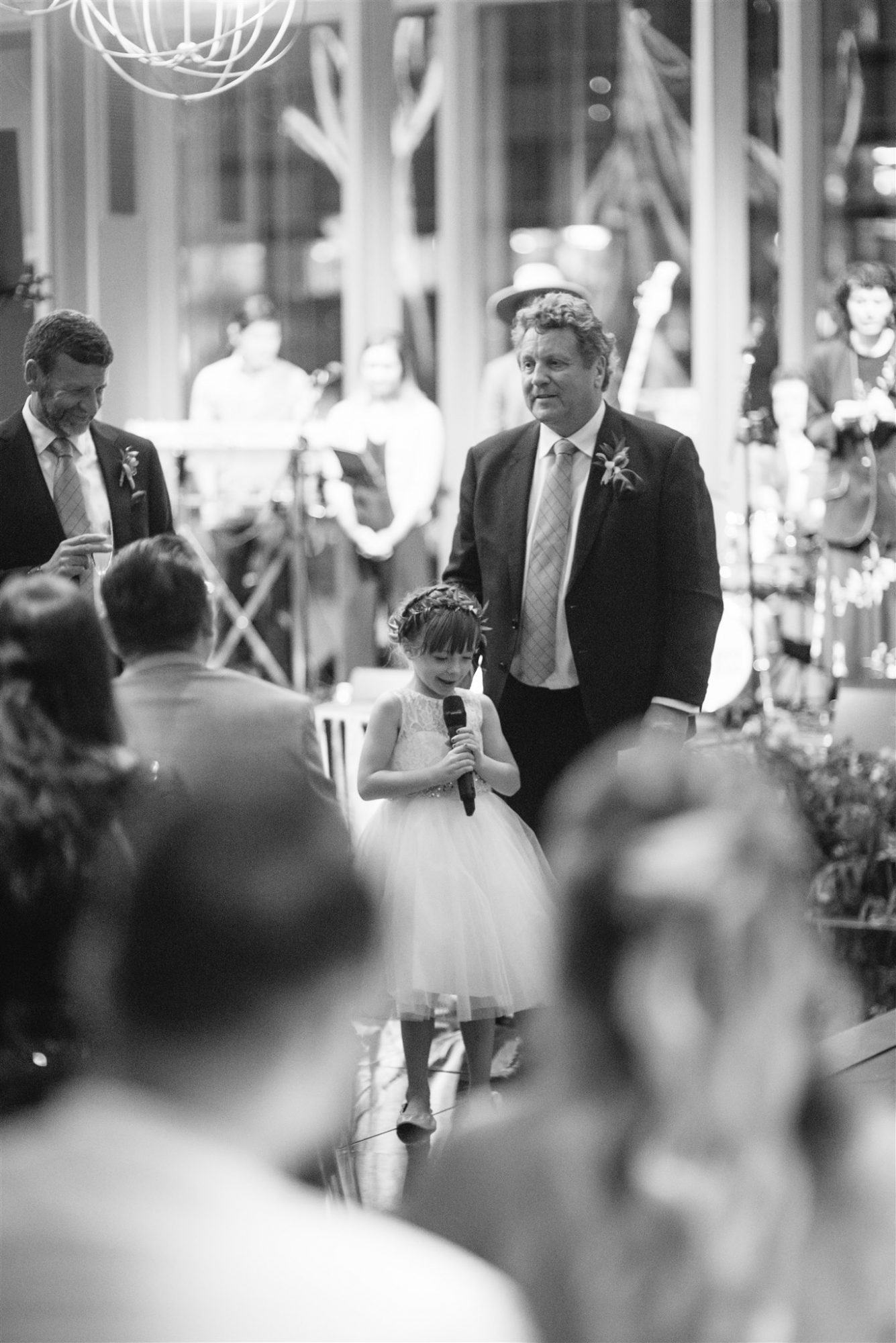 black and white photo flower girl giving speech