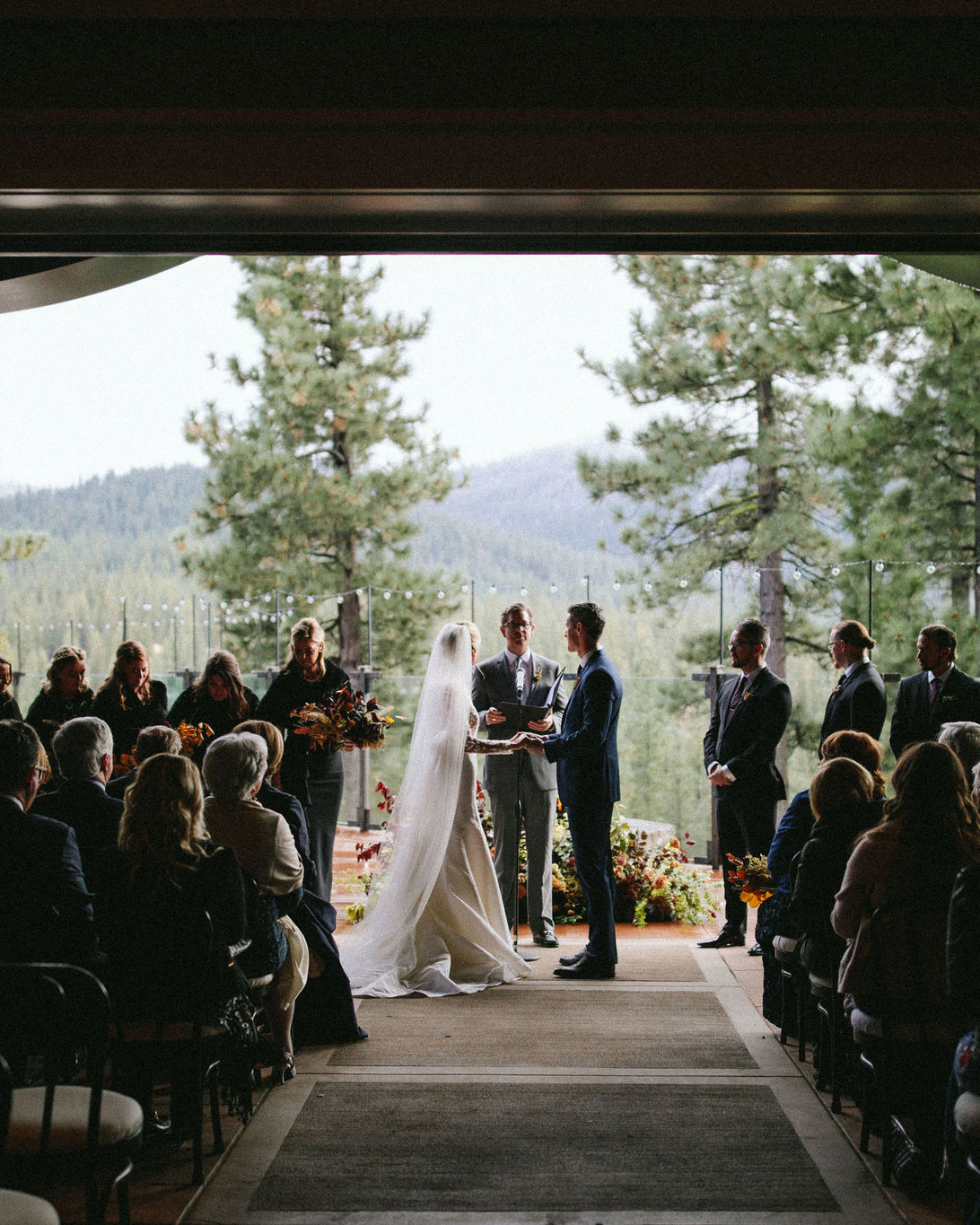 clare tim wedding ceremony with mountain view