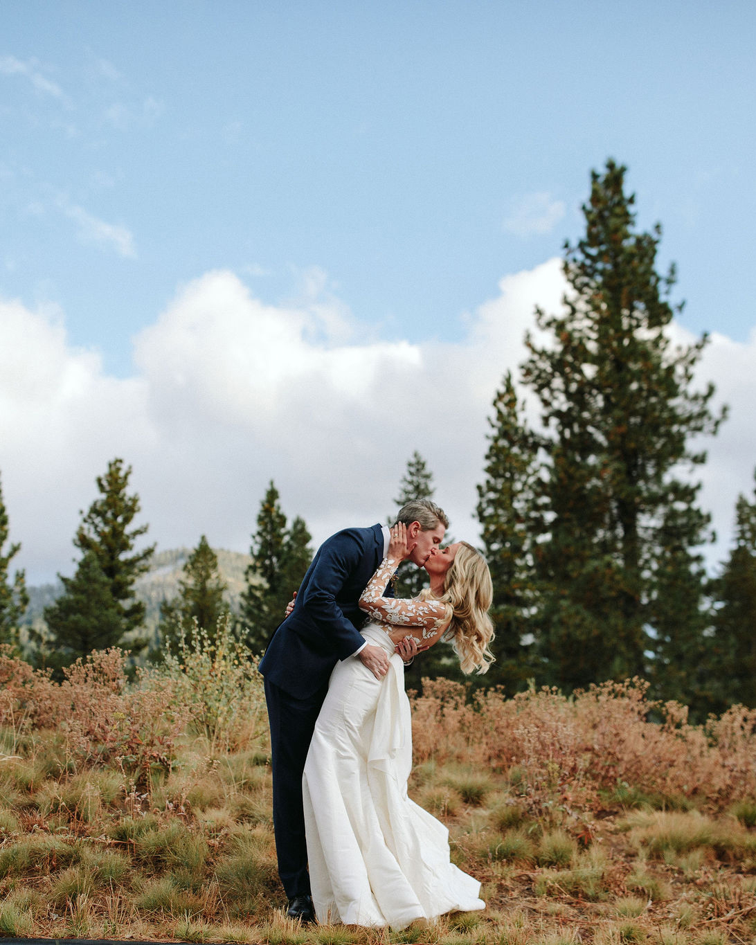 clare tim wedding couple kissing in fall setting