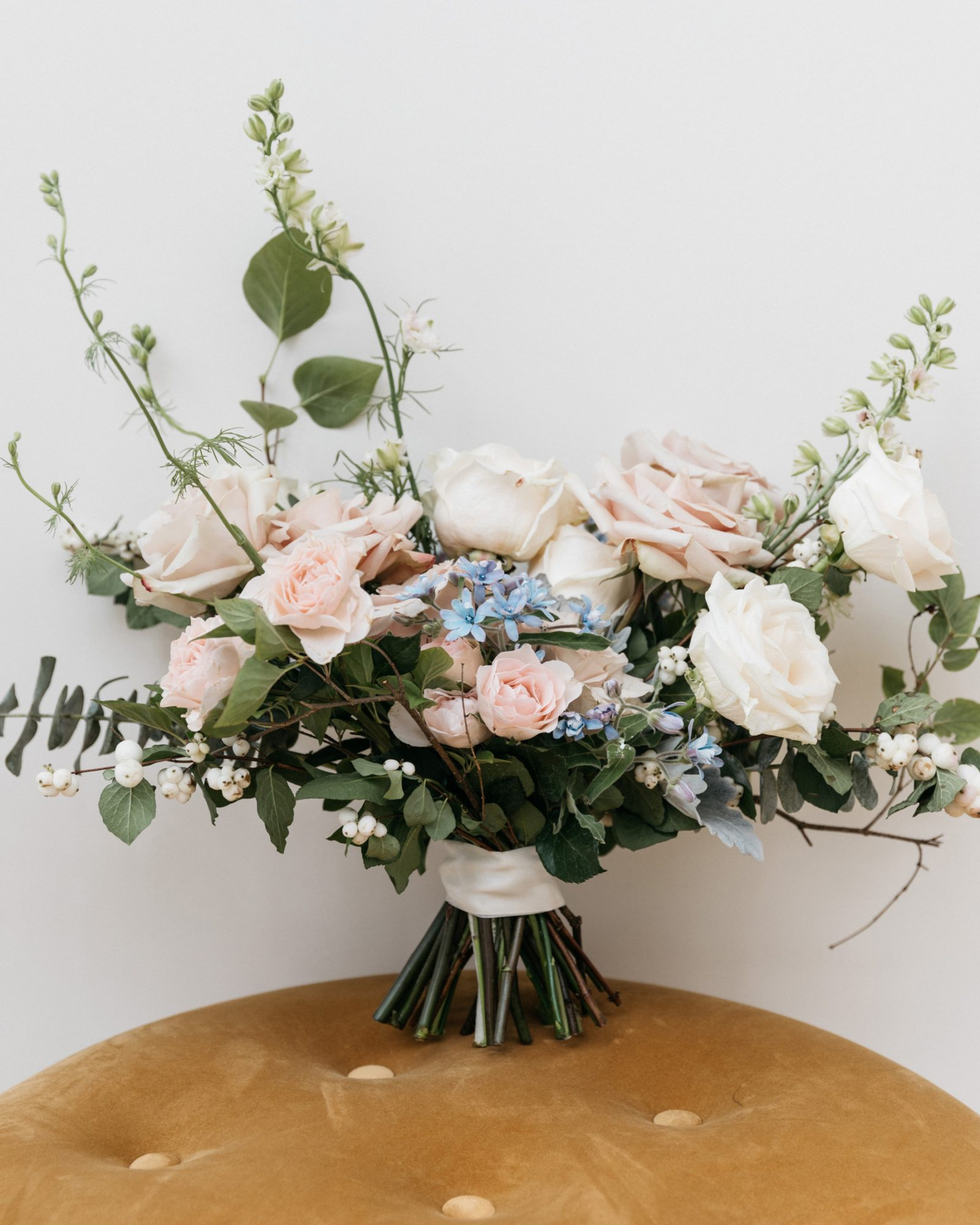 wedding bouquet with white pink blue flowers