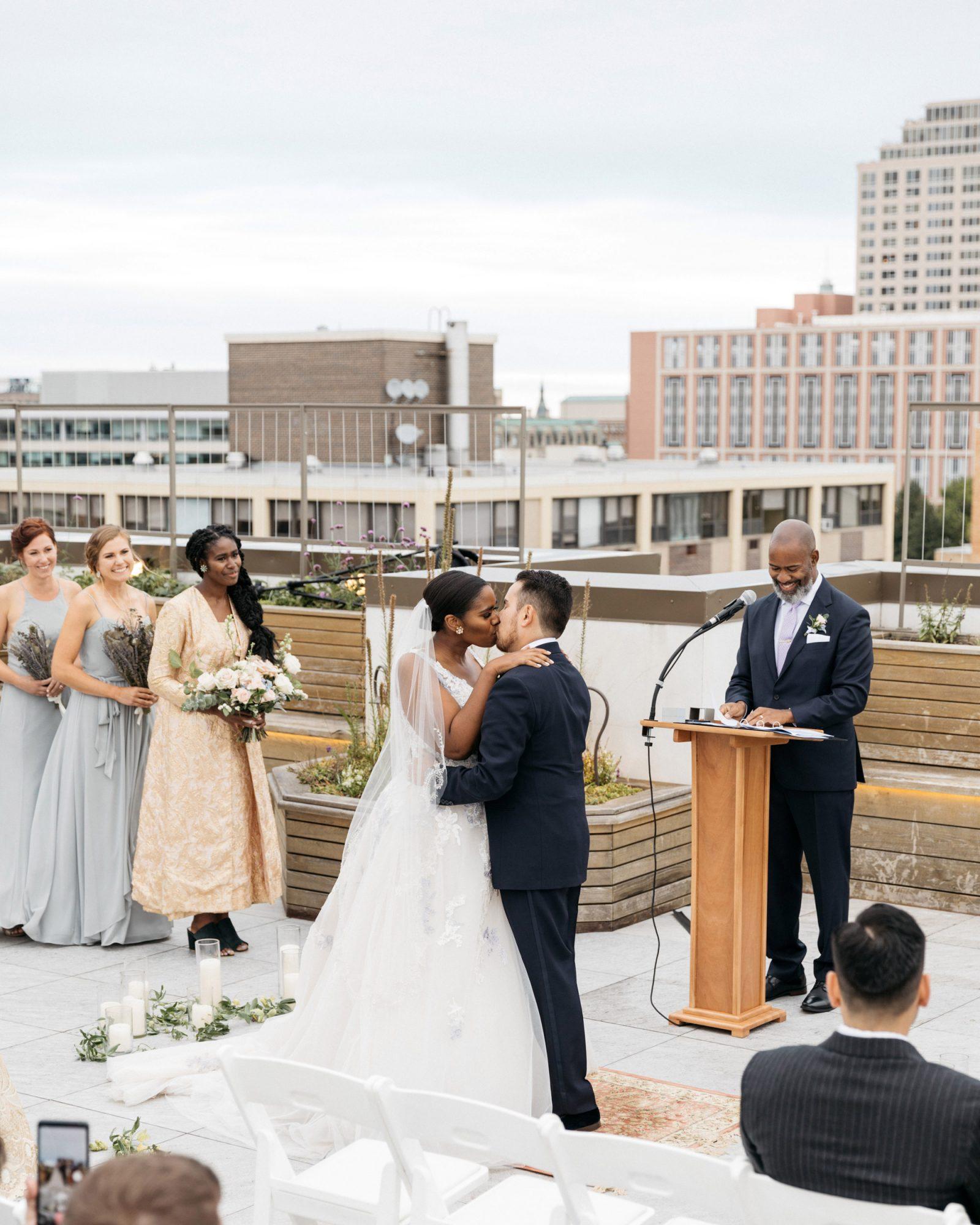 rooftop ceremony bride groom kissing