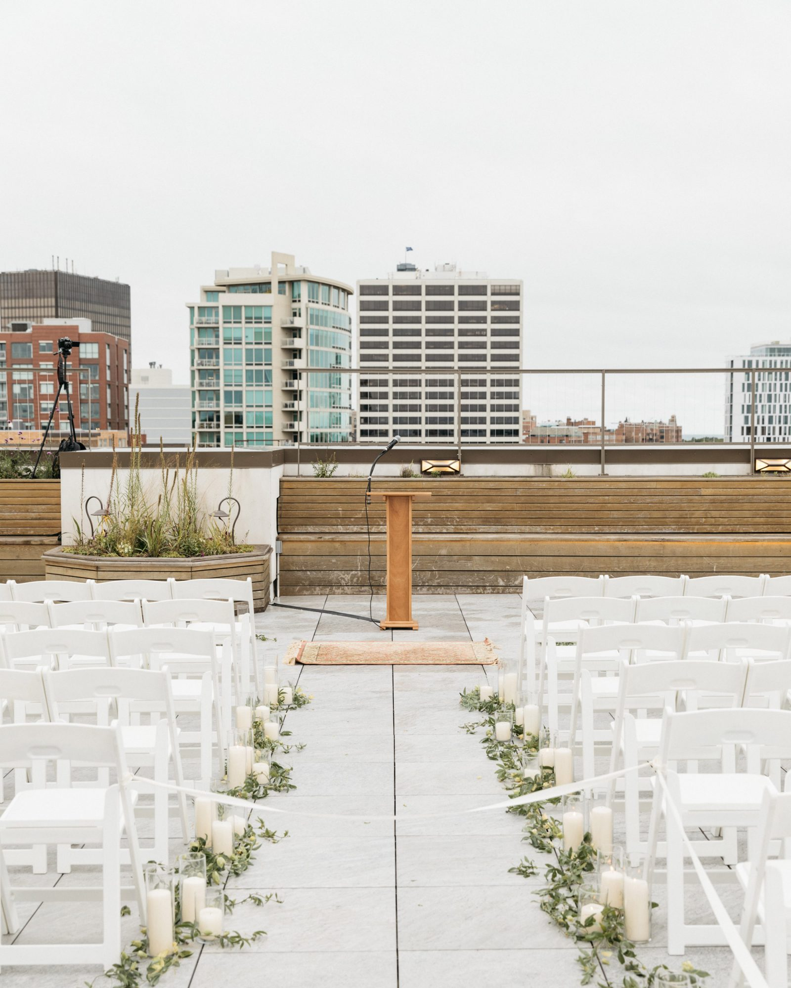 rooftop ceremony space wooden altar rows of white chairs