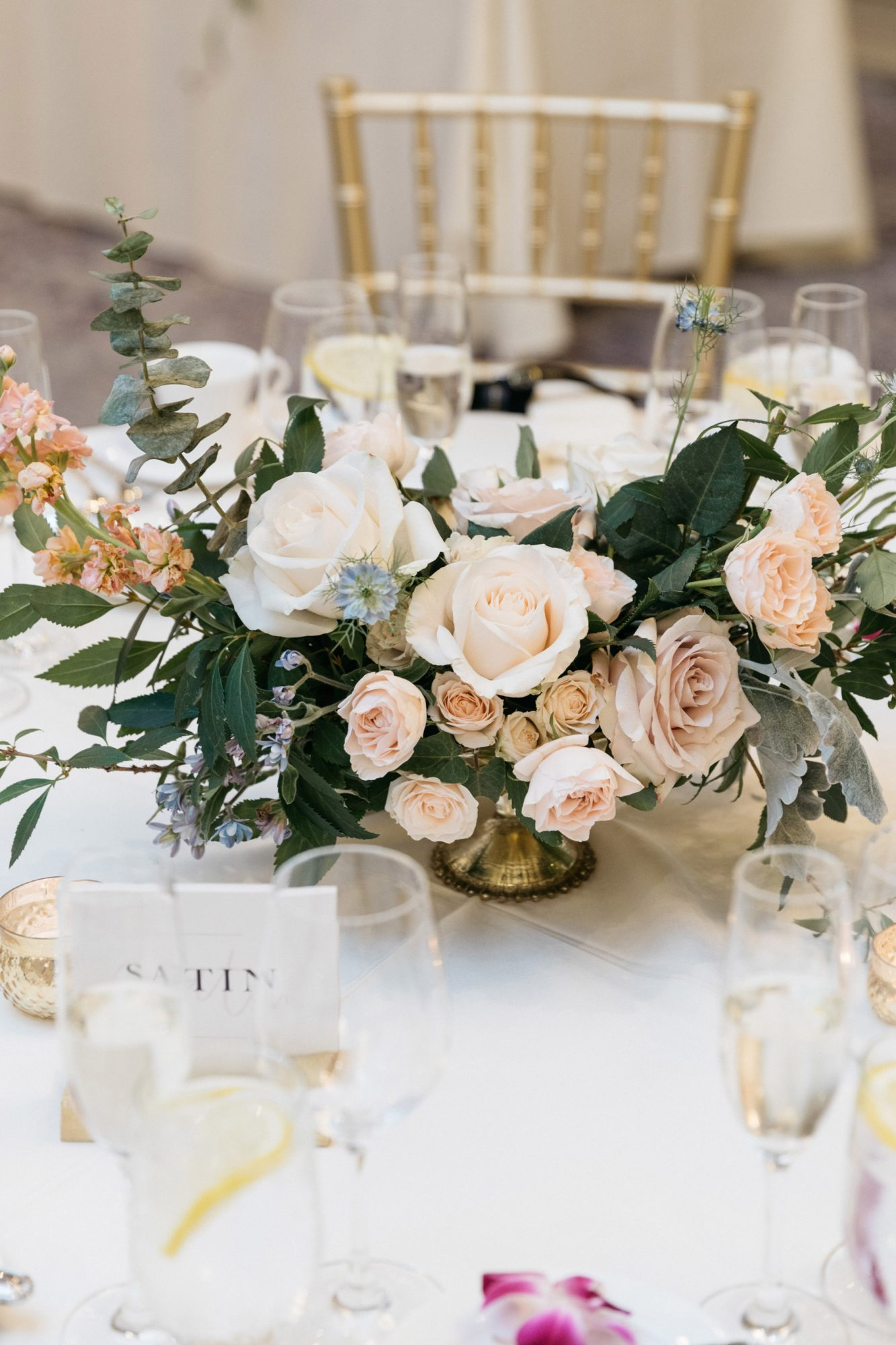 reception table centerpiece white peach flowers
