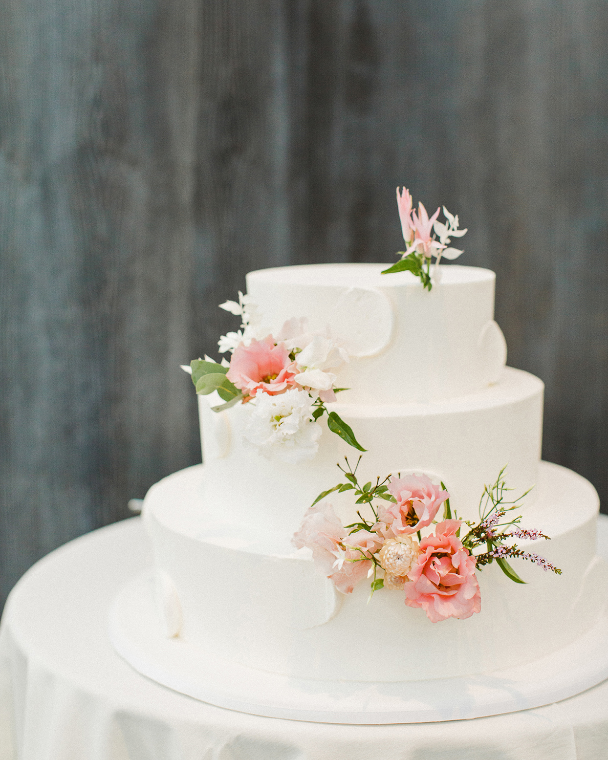 grace john white wedding cake with simple pink flowers