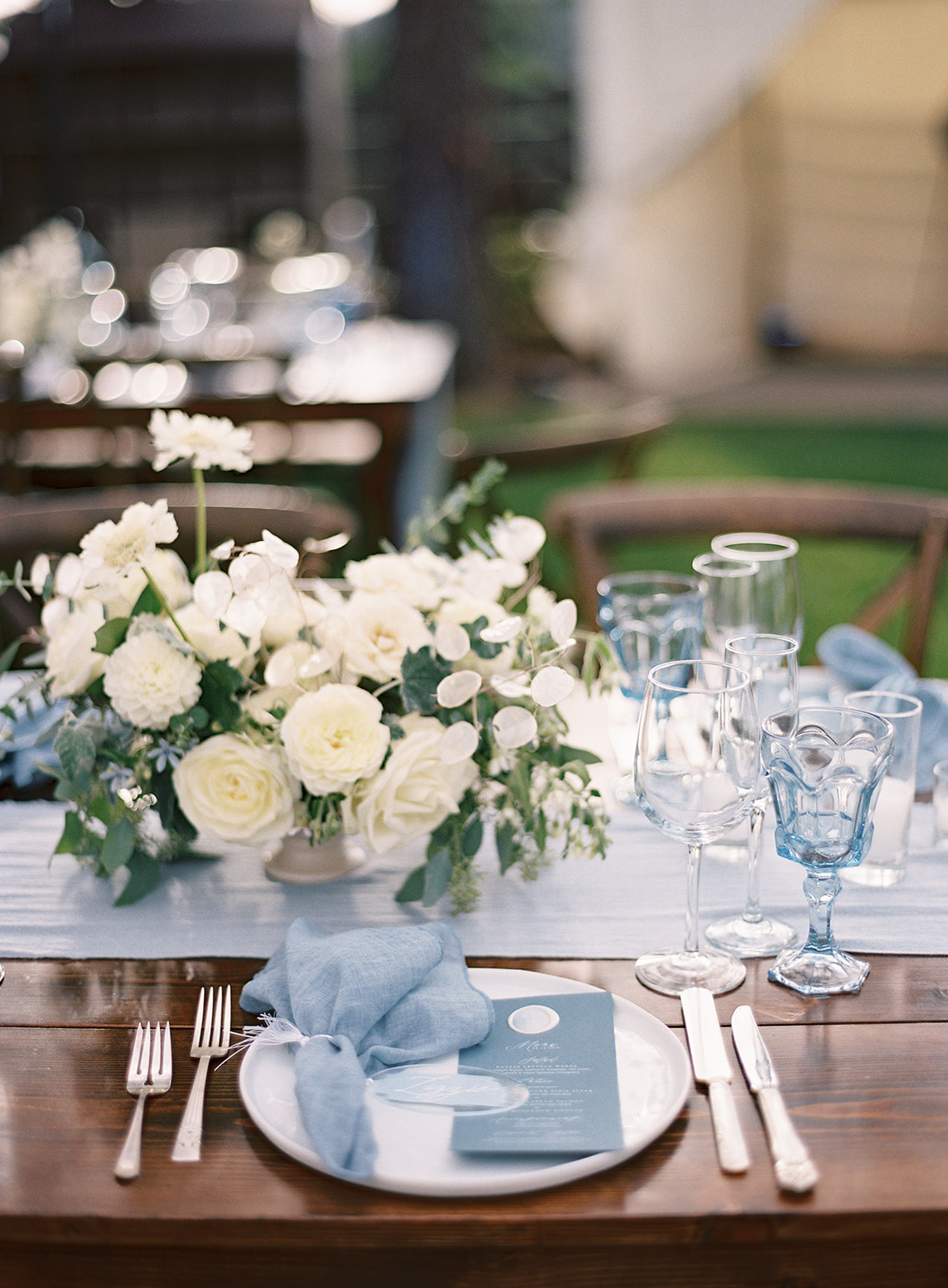 light blue and white wedding reception place settings