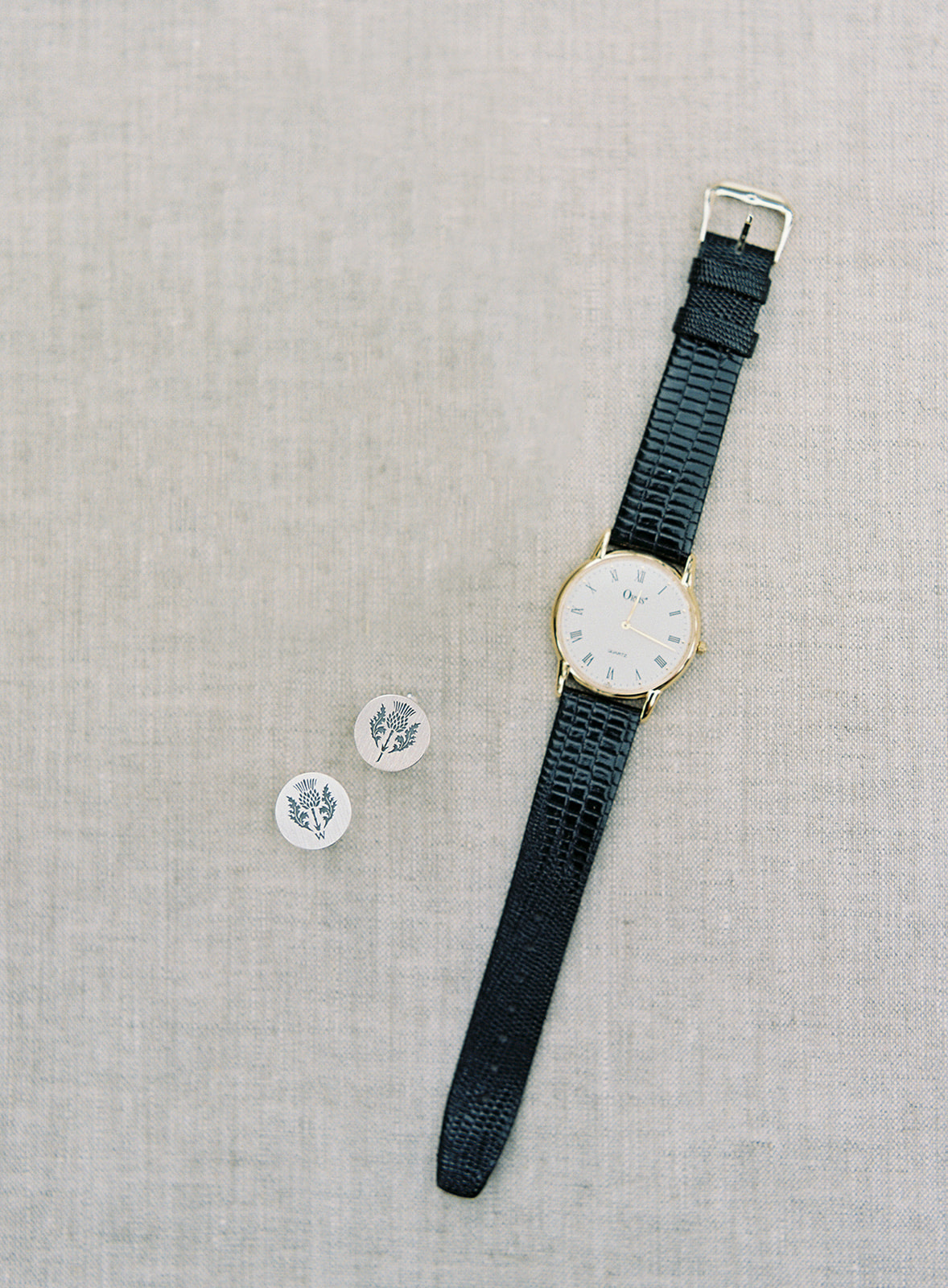 black leather band with gold accent wrist watch