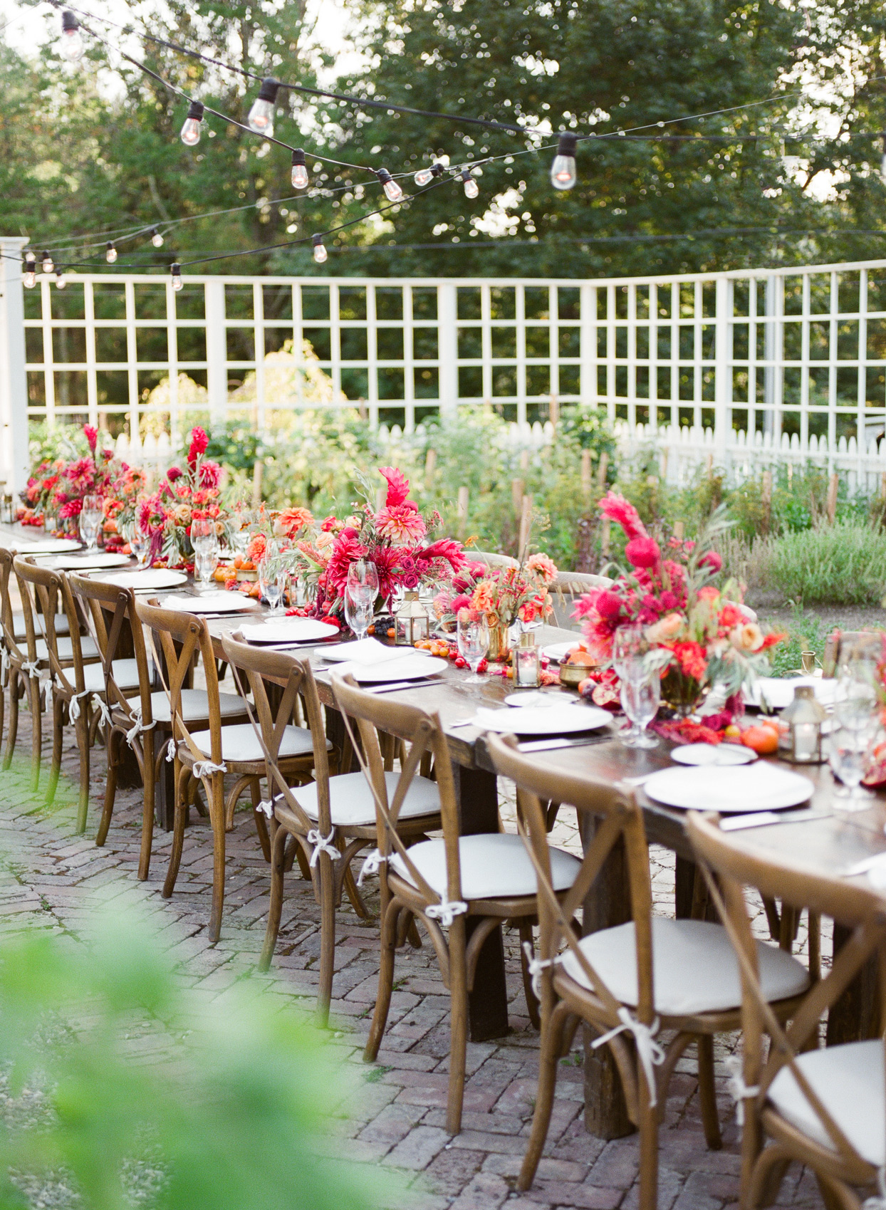 rehearsal dinner table setting in outdoor garden