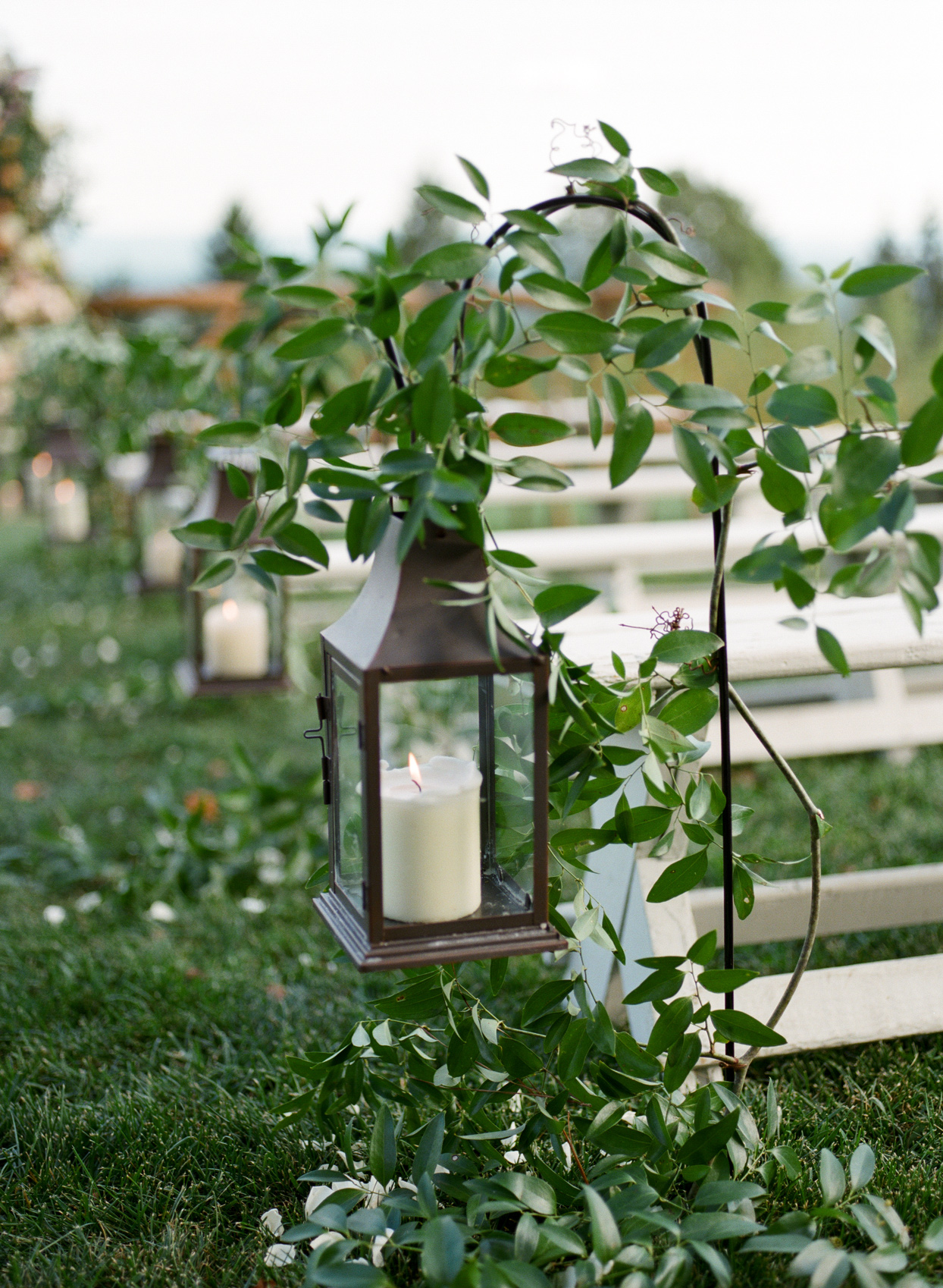 ceremony aisles lined with hanging lanterns