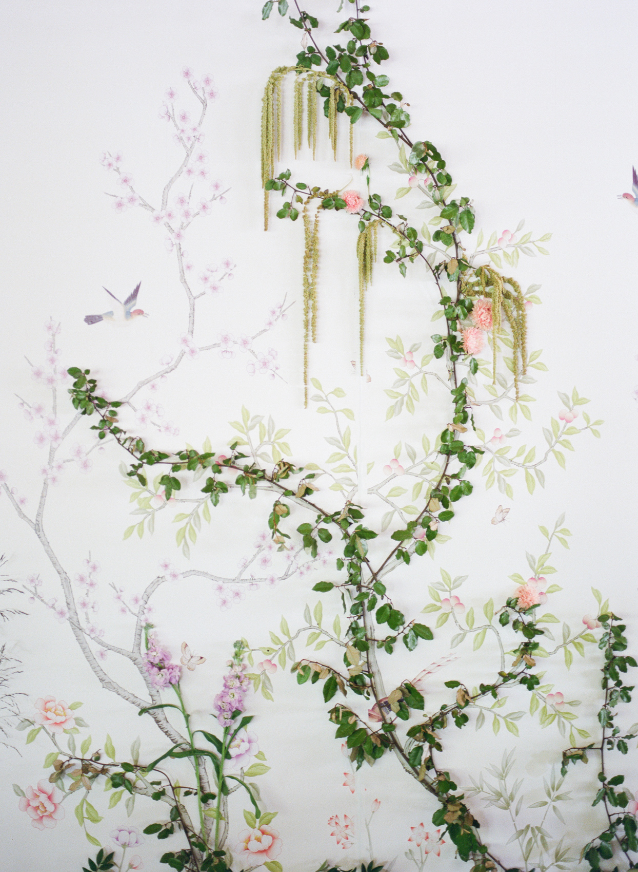 wedding reception backdrop of custom wallpaper and flowers