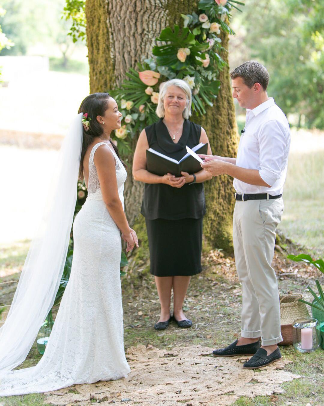jen tim wedding ceremony in front of tree