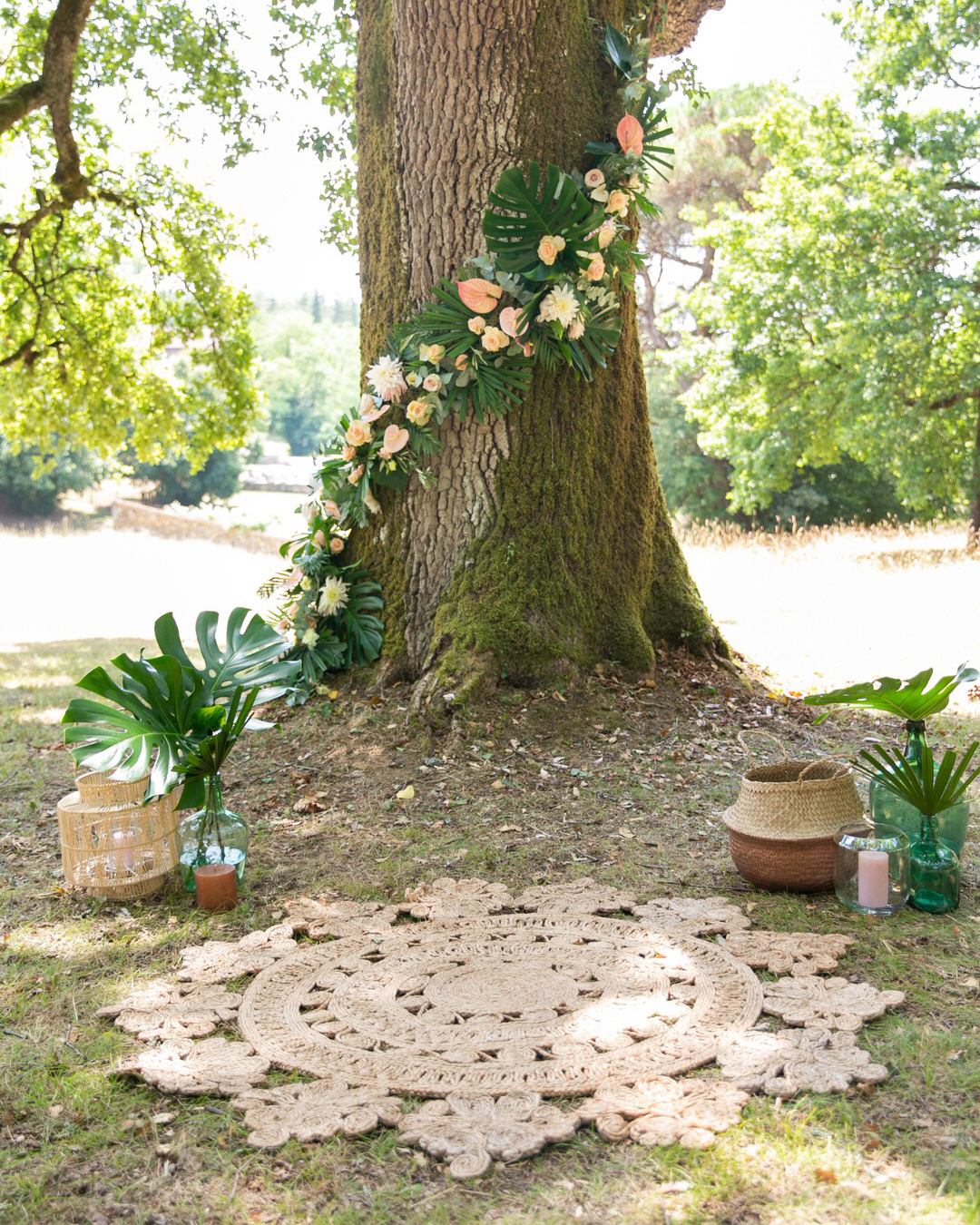 jen tim wedding ceremony tree wrapped in tropical garland