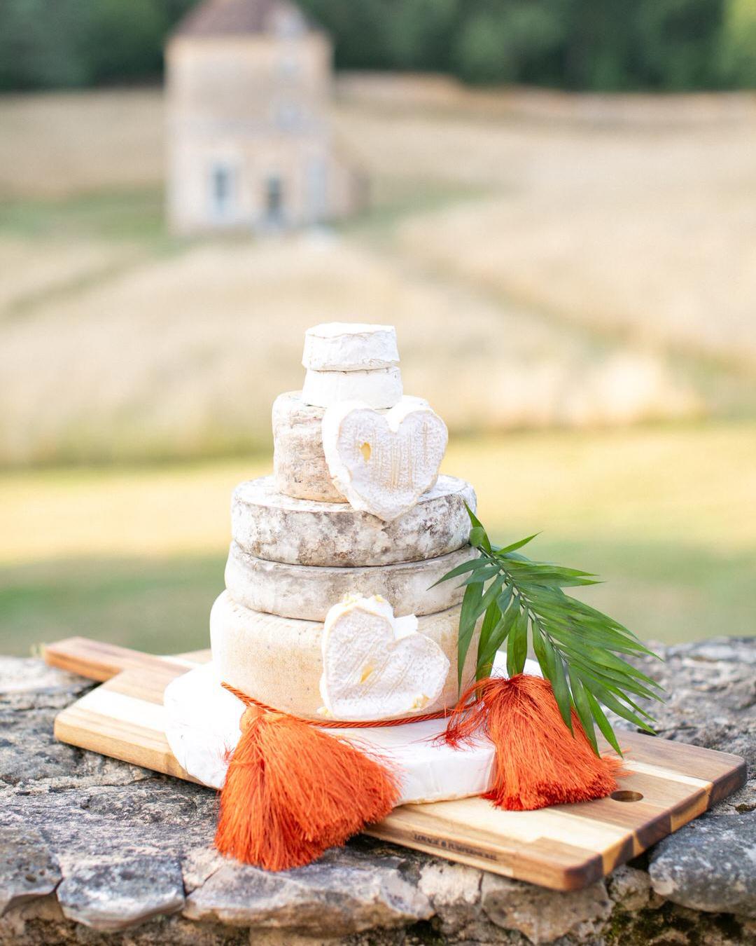 jen tim wedding cheesecake on wooden board