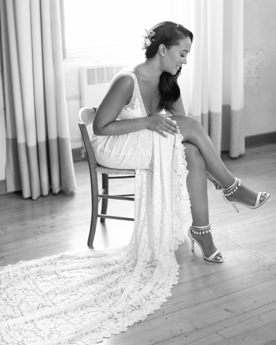 jen tim bride in wedding dress putting on shoes